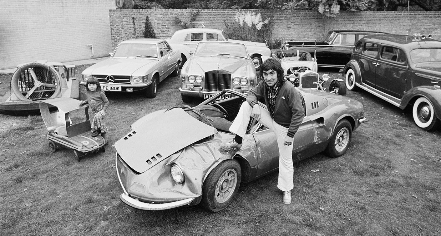 ferrari eric clapton with Snapshot 1972 Damaged Dino And Sheepish Keith Moon on Steve Mcqueen Style The King Of Cool additionally Private Garage together with Multi Million Dollar Swap Shop Car Collection besides Ferrari J50 Unveiled also Rolls Royce Phantom V Psychedelic Tout John Lennon Dans Une Voiture.