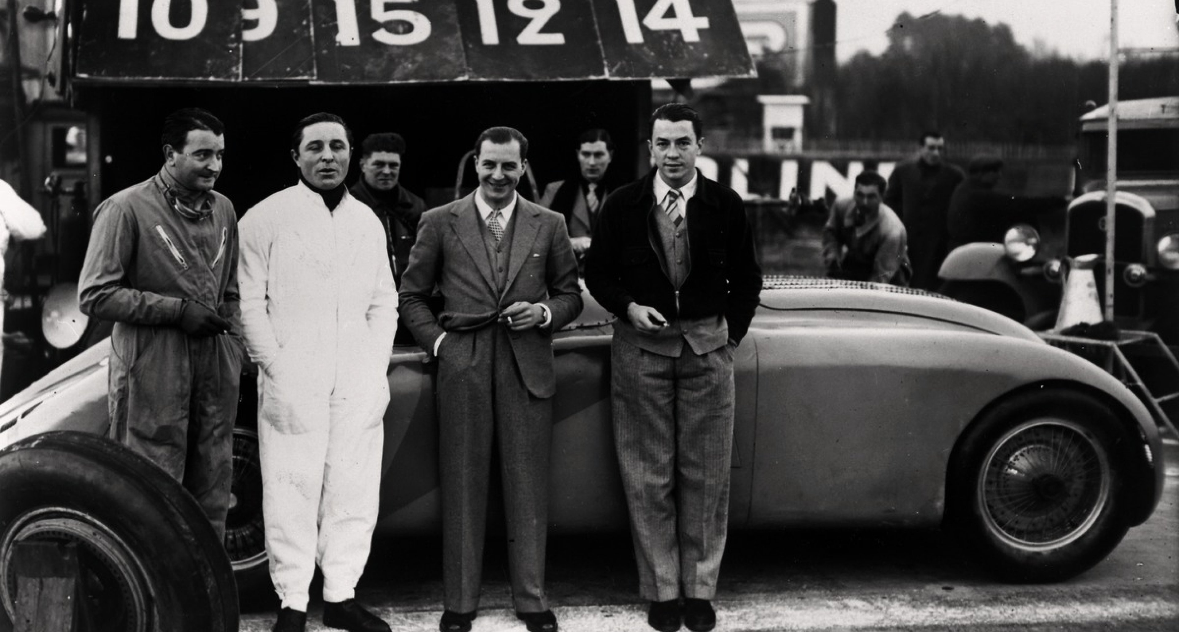 "The factory drivers ""Williams"", Veyron (from left) and Wimille (far right) with Jean Bugatti (between them) in front of the Type 57G Tank."