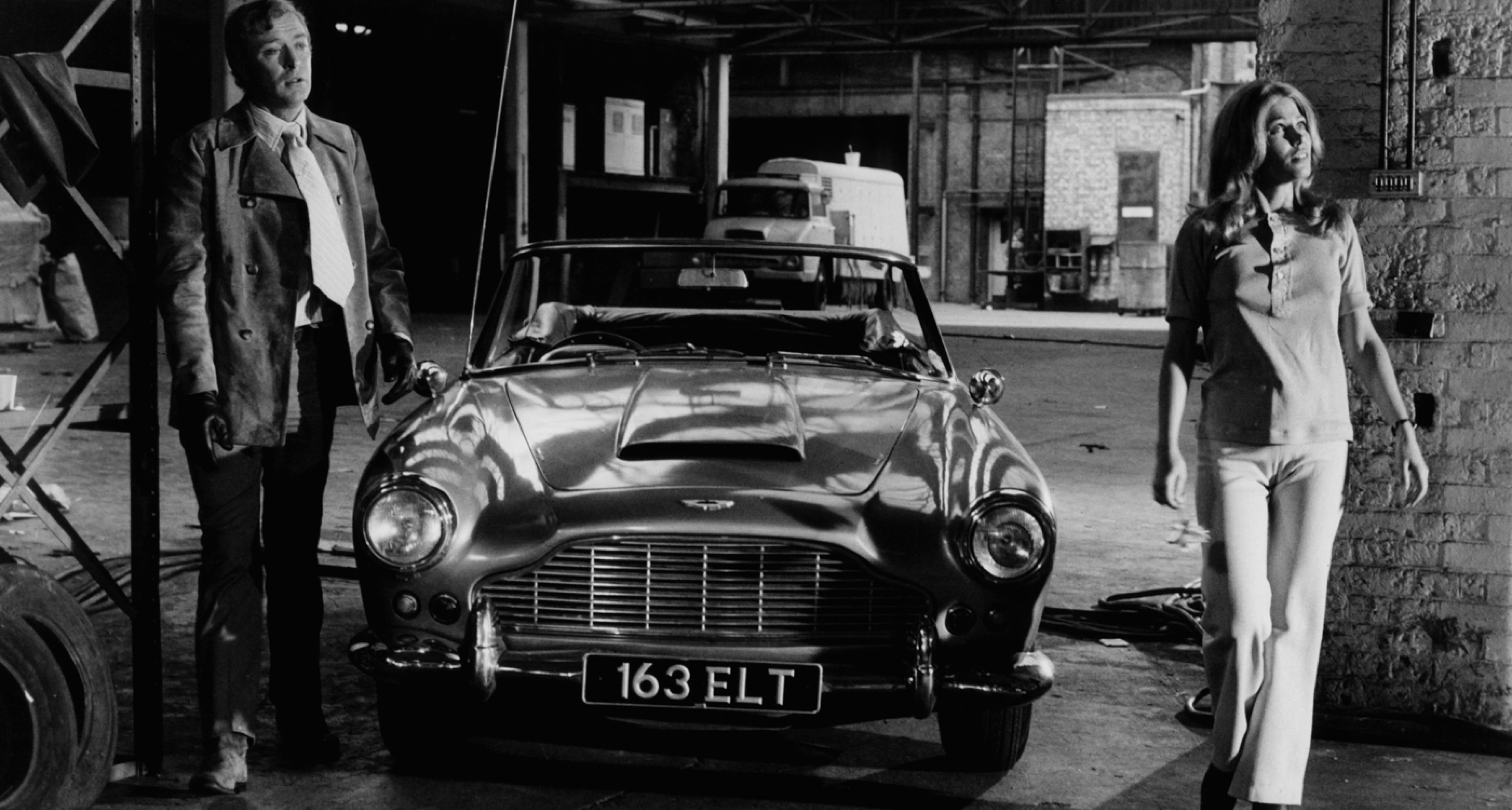 Michael Caine and an Aston Martin DB4 in 'The Italian Job' (1969).