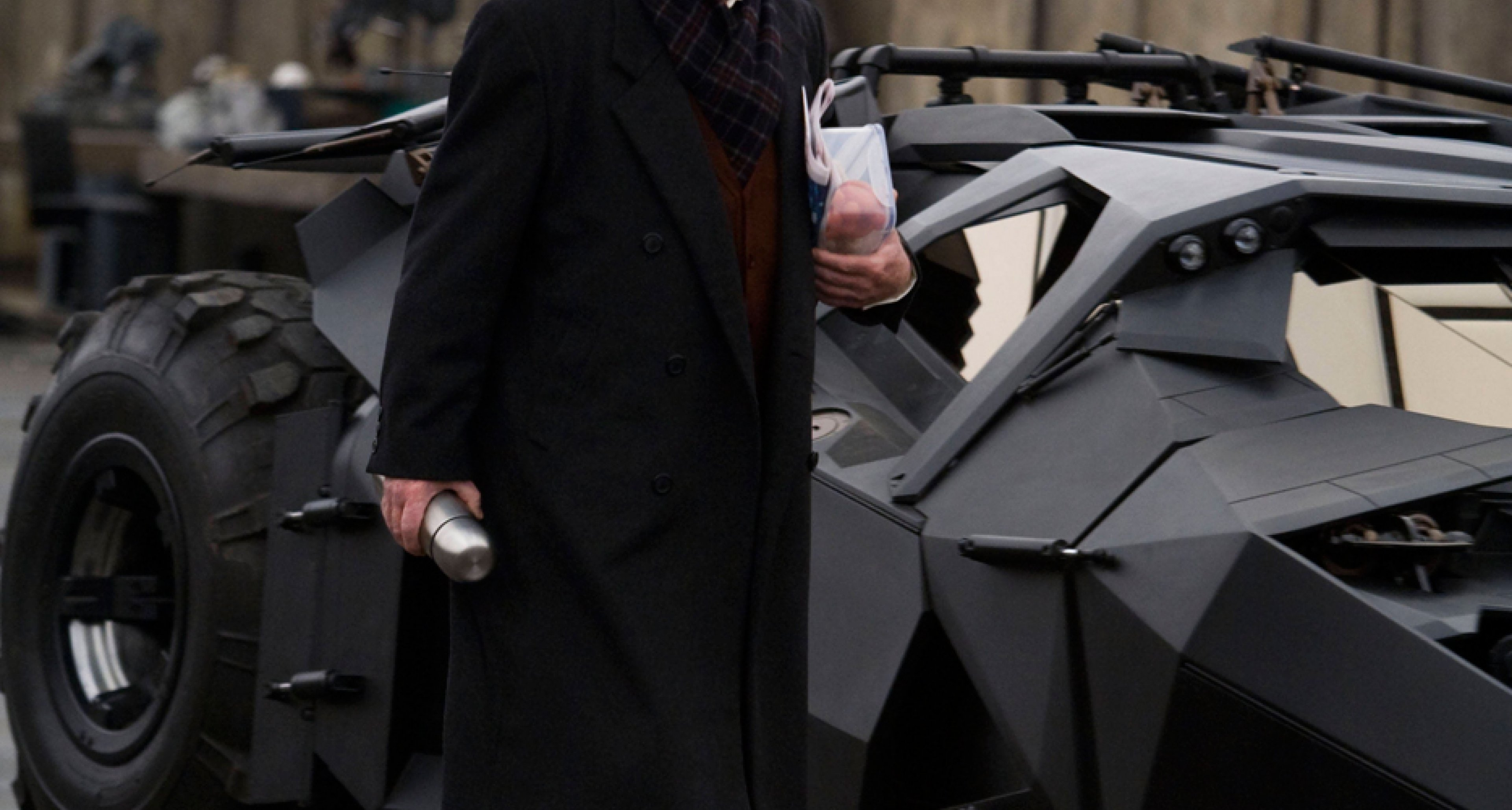 Michael Caine as butler Alfred Pennyworth, preparing the Batmobile for 'The Dark Knight Rises' (2012).