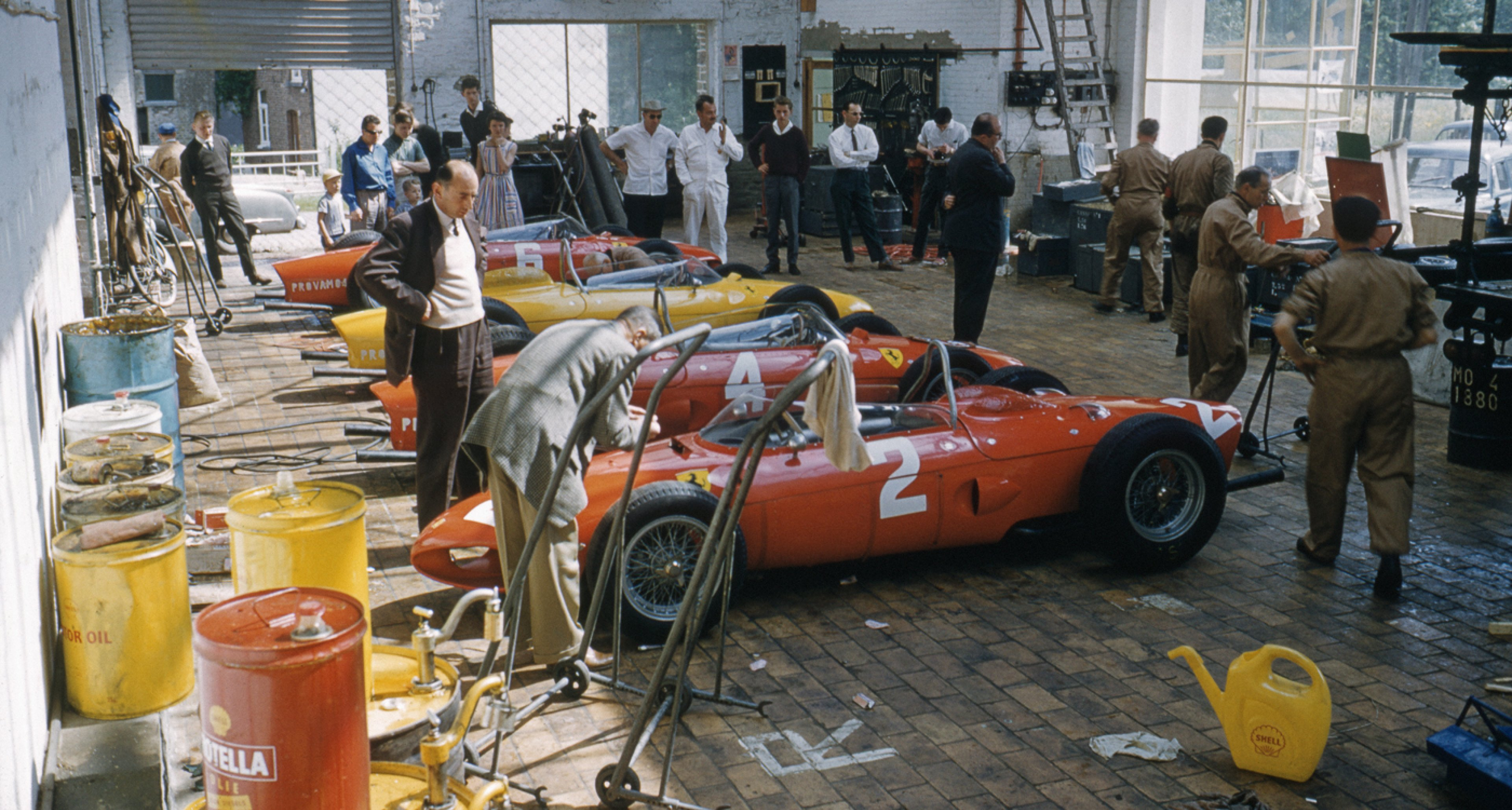 Carlo Chitti and his mechanics at the Ferrari paddock during the Belgian Grand Prix in 1961.