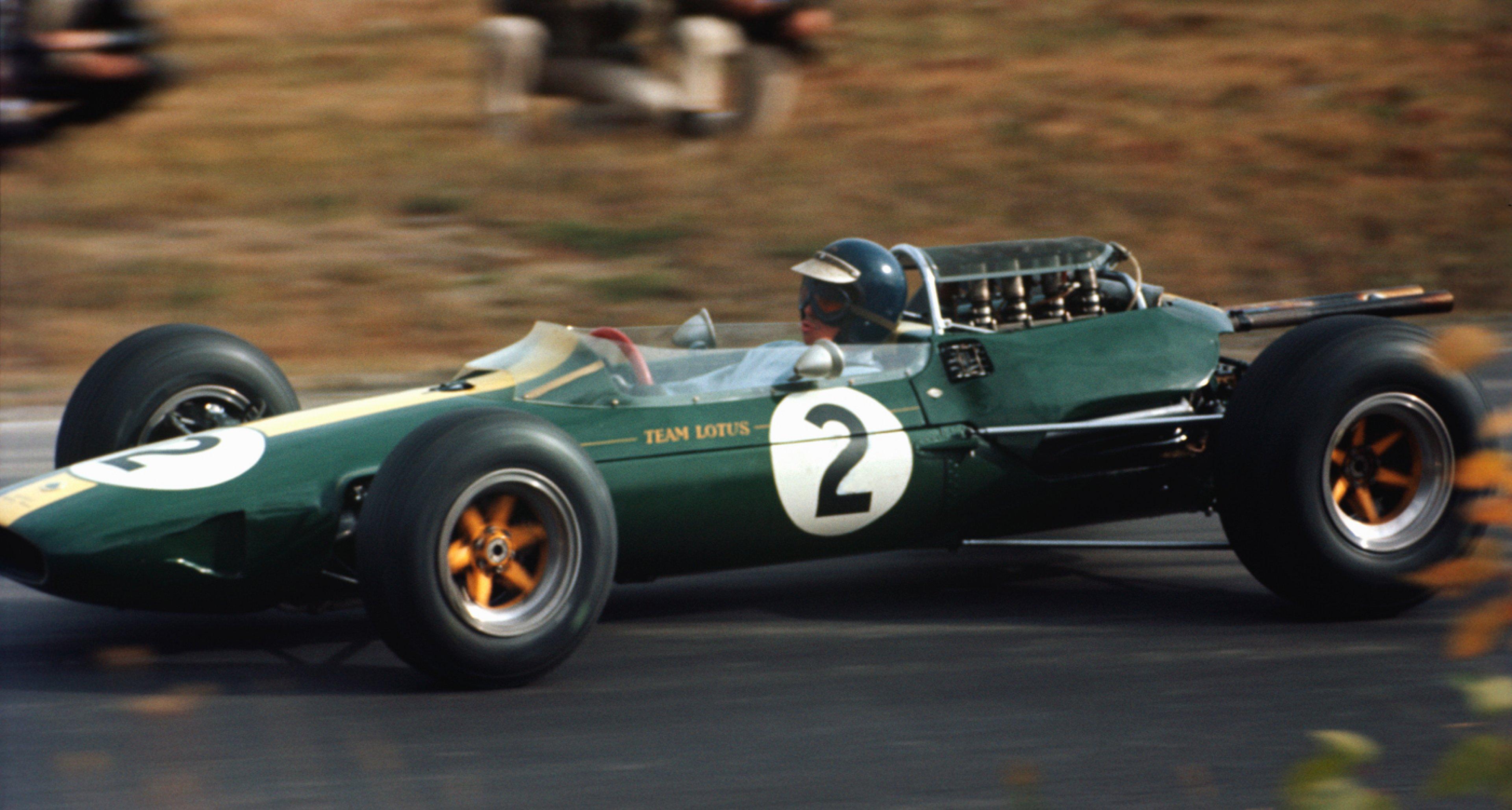 Jim Clark races his Lotus in 1964.