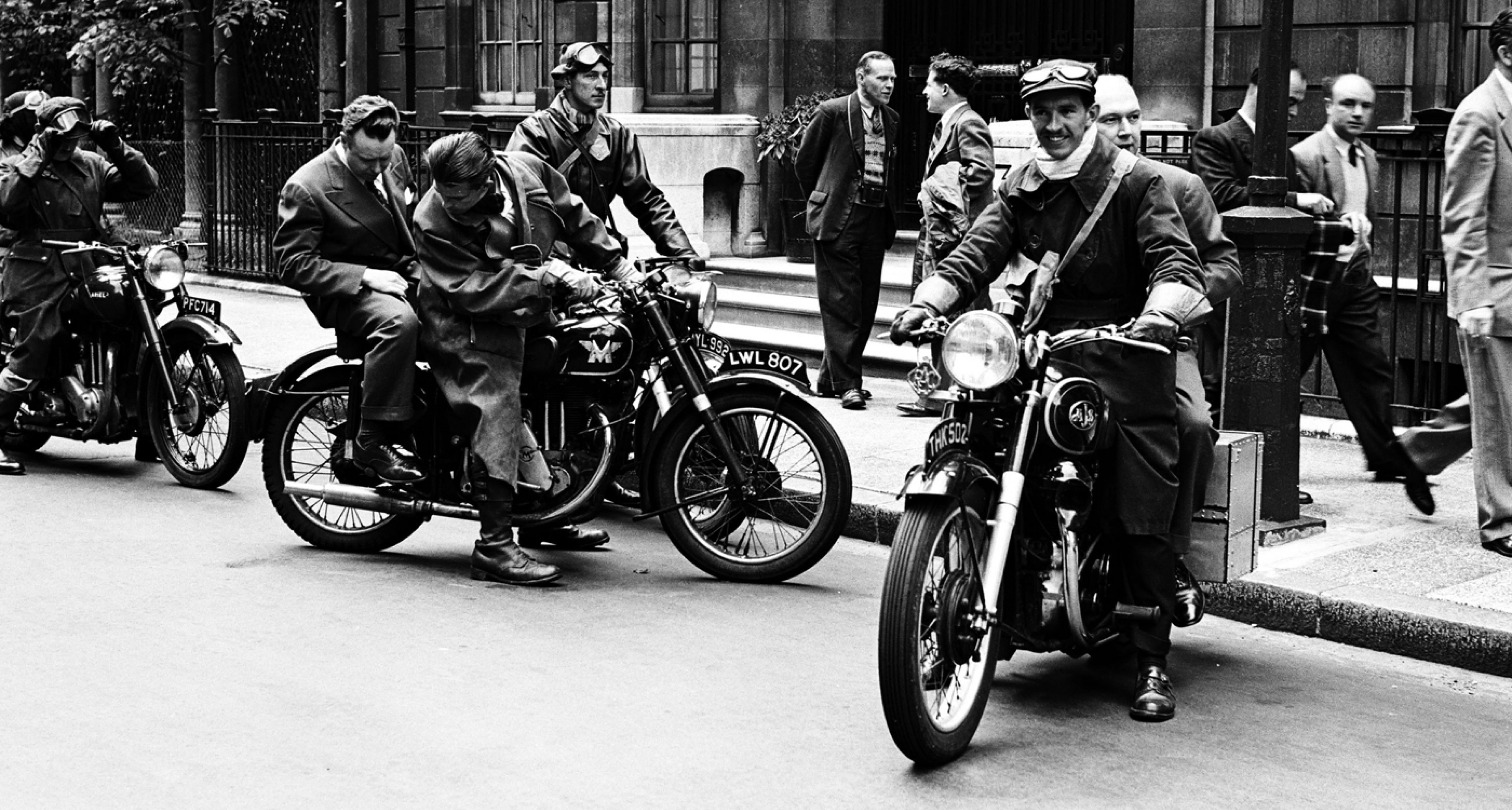 NBC News' Merrill 'Red' Mueller (left in suit) on a motorcycle during the coronation of Queen Elizabeth II on June 2, 1953 in London, England.