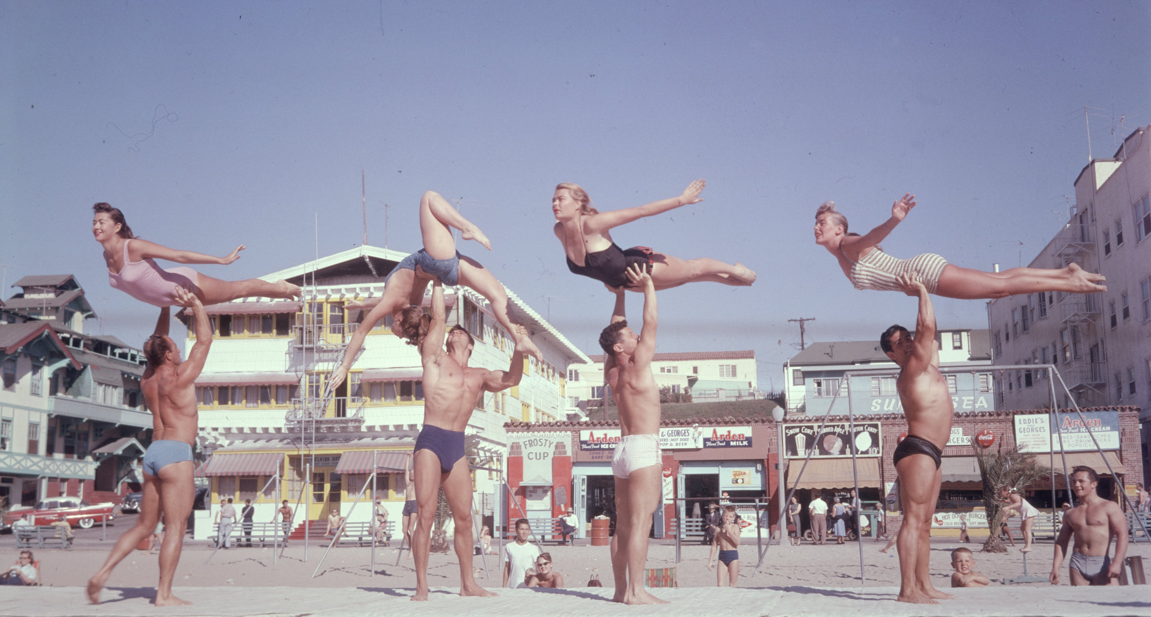 Stunt performers on Muscle Beach, Santa Monica, California in 1956.