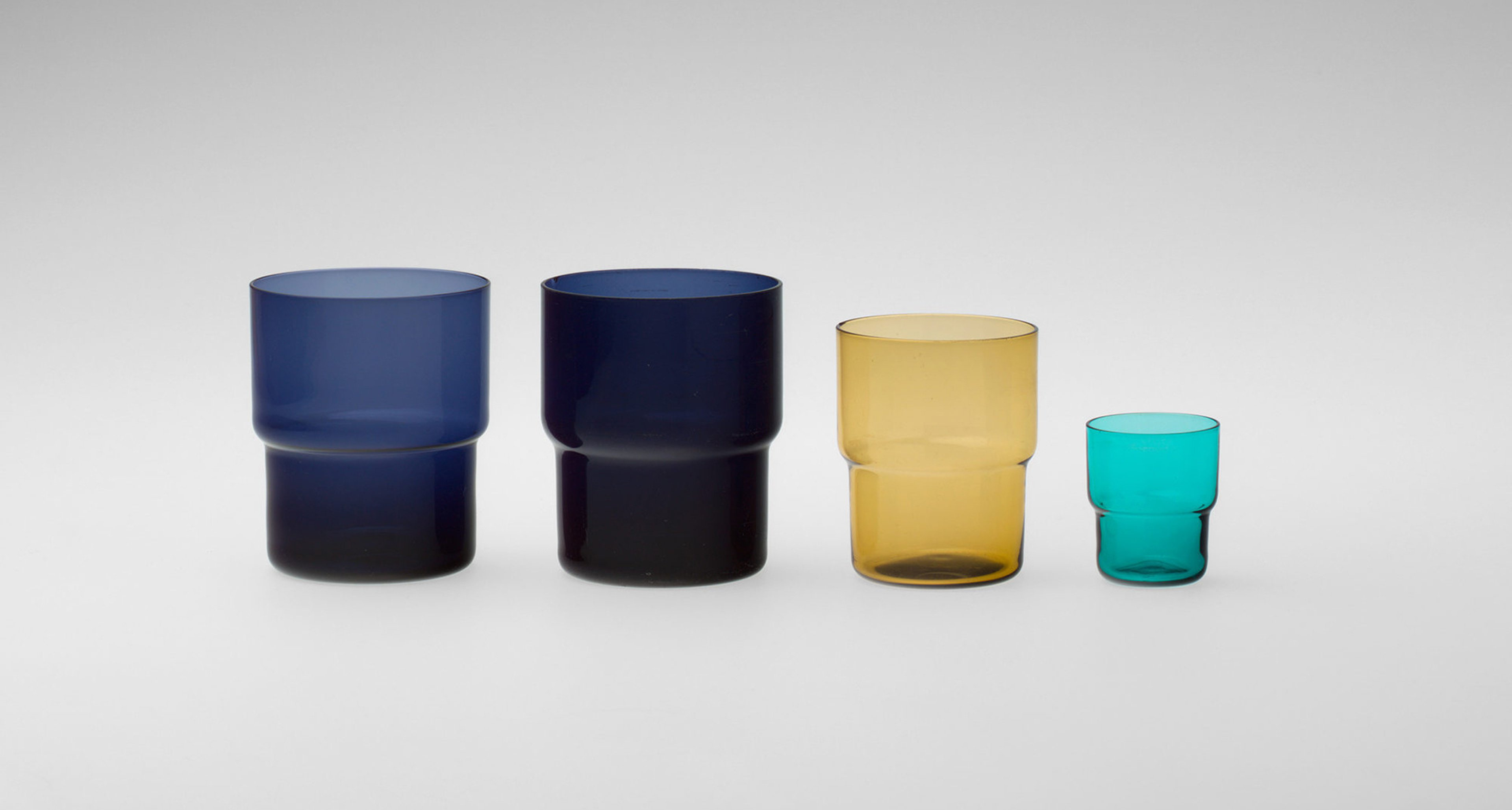 Saara Hopea (Finnish, 1925–1984). Stacking Glasses. 1951. Blown glass, .1‑.2 (blue): 3 3/8 × 2 7/8″ (8.6 × 7.3 cm); .3 (yellow): 2 15/16 x 2 3/8″ (7.5 x 6 cm); .4 (turquoise): 1 7/8 x 1 9/16″ (4.7 x 4 cm). Manufactured by Nuutajärvi Glass Works (Wärtsilä,