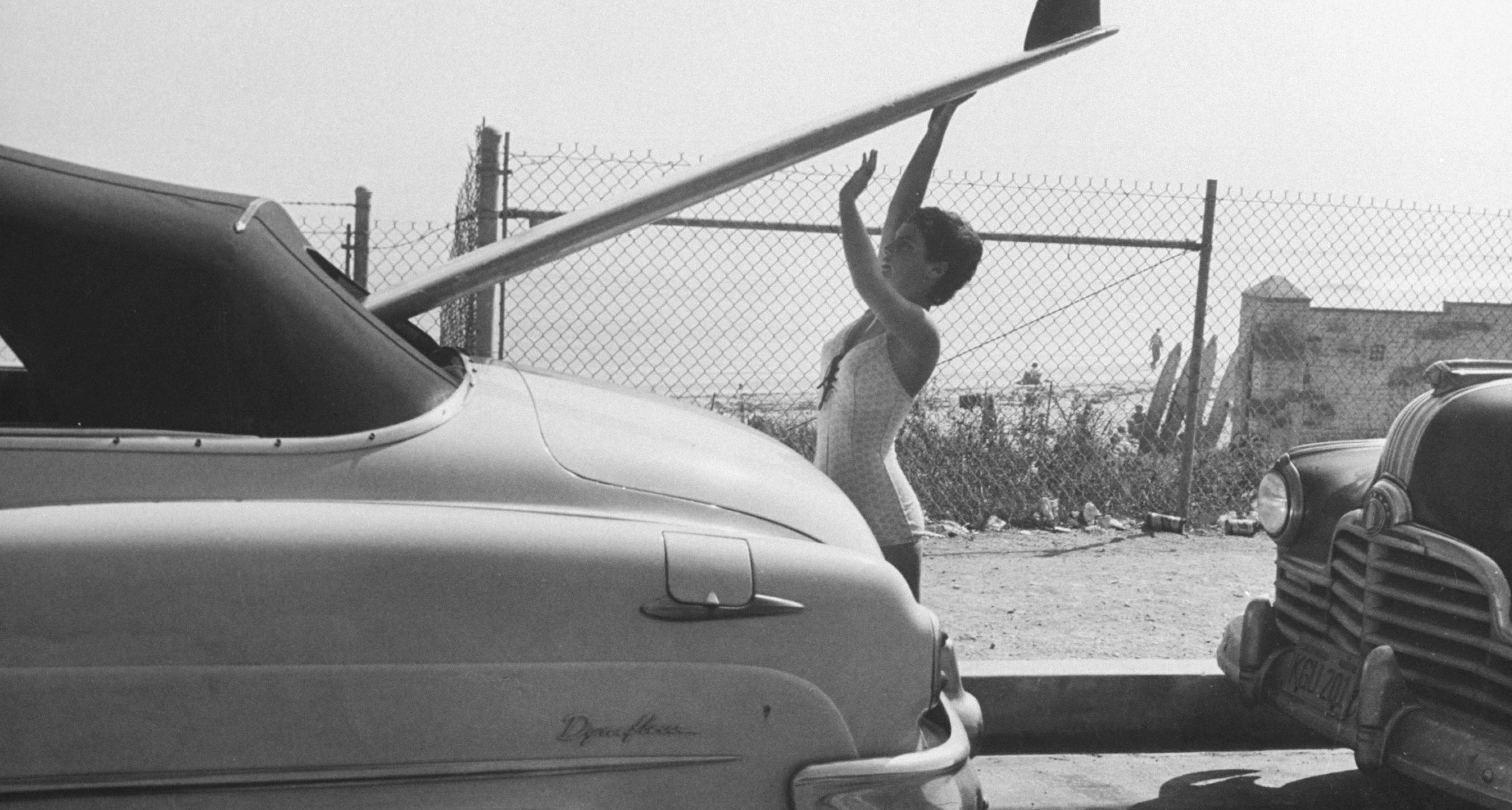 16 yr. old surfer Kathy (Gidget) Korner, while loading board into family car.