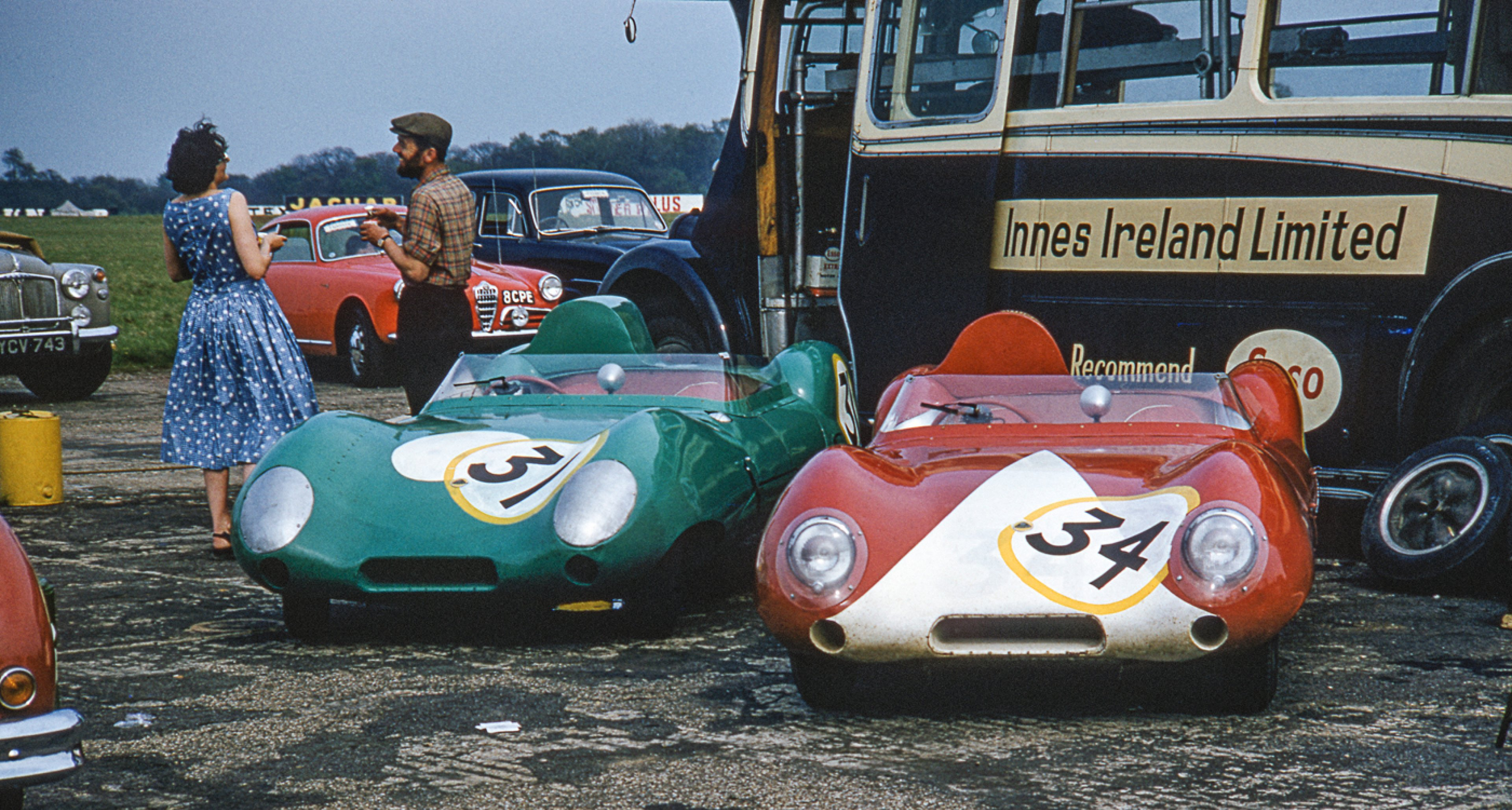 Innes Ireland and J. Westcott's Lotus XVs waiting in the paddock at the 1958 International Trophy Meeting in Silverstone.