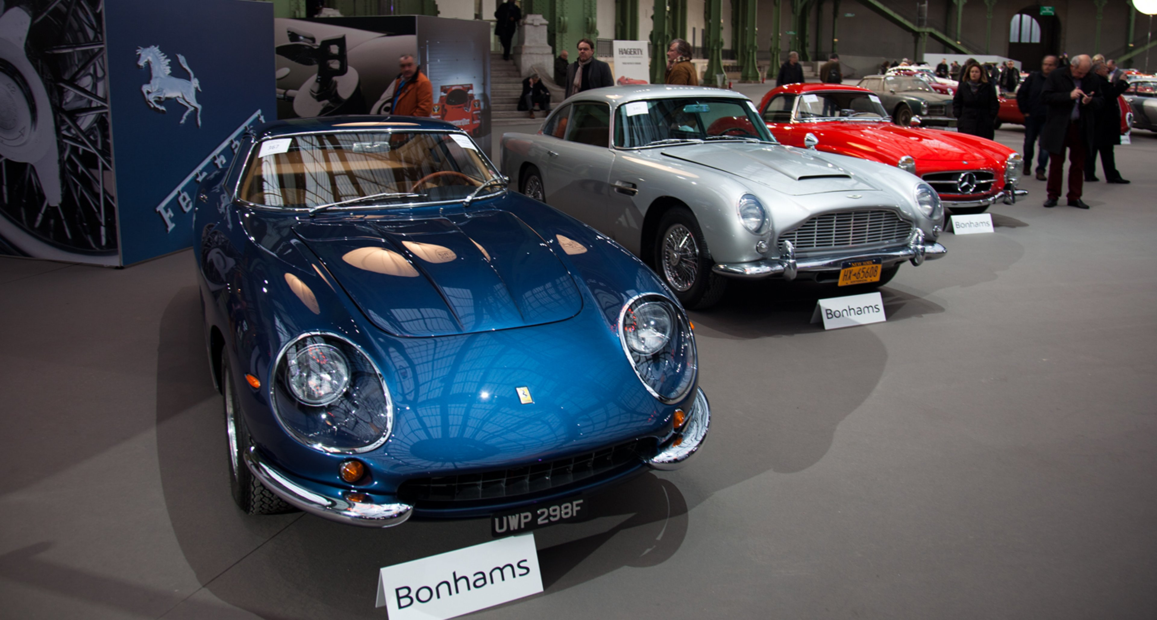 Million dollar beauties at Bonhams' Retromobile sale 2014 at Grand Palais, Paris: Ferrari 275GTB/4 (sold for €2,218,333), Aston Martin DB5 (sold for €776,250) and Mercedes 300SL Roadster (sold for € 713.000).