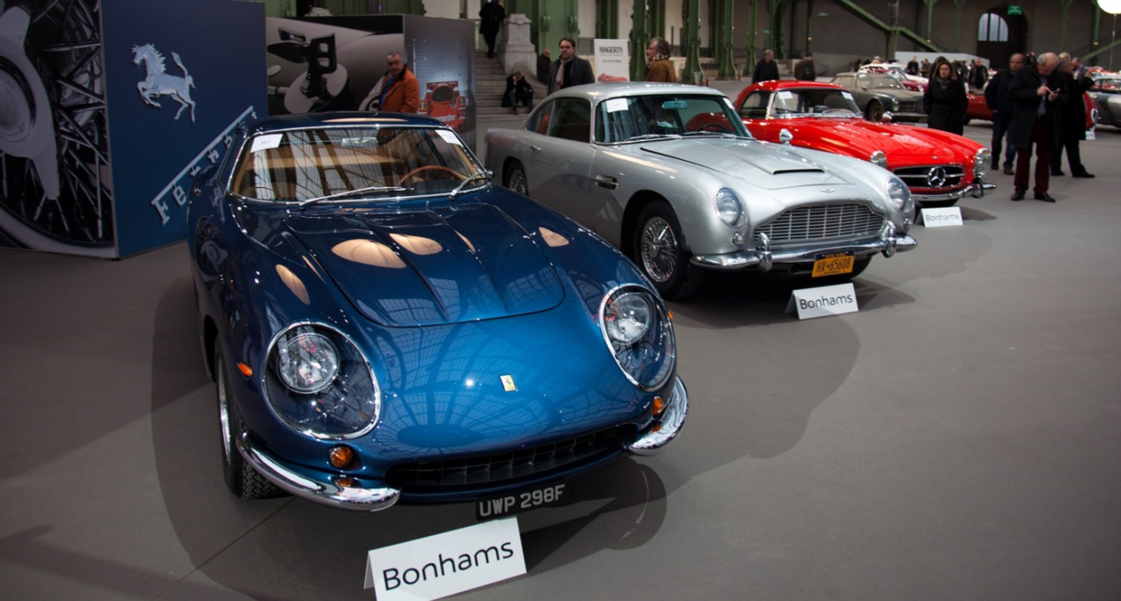 Million dollar beauties at Bonhams' Retromobile sale 2014 at Grand Palais, Paris: Ferrari 275GTB/4 (sold for €2,218,333), Aston Martin DB5 (sold for €776,250) and Mercedes 300SL Roadster (sold for €713,000).