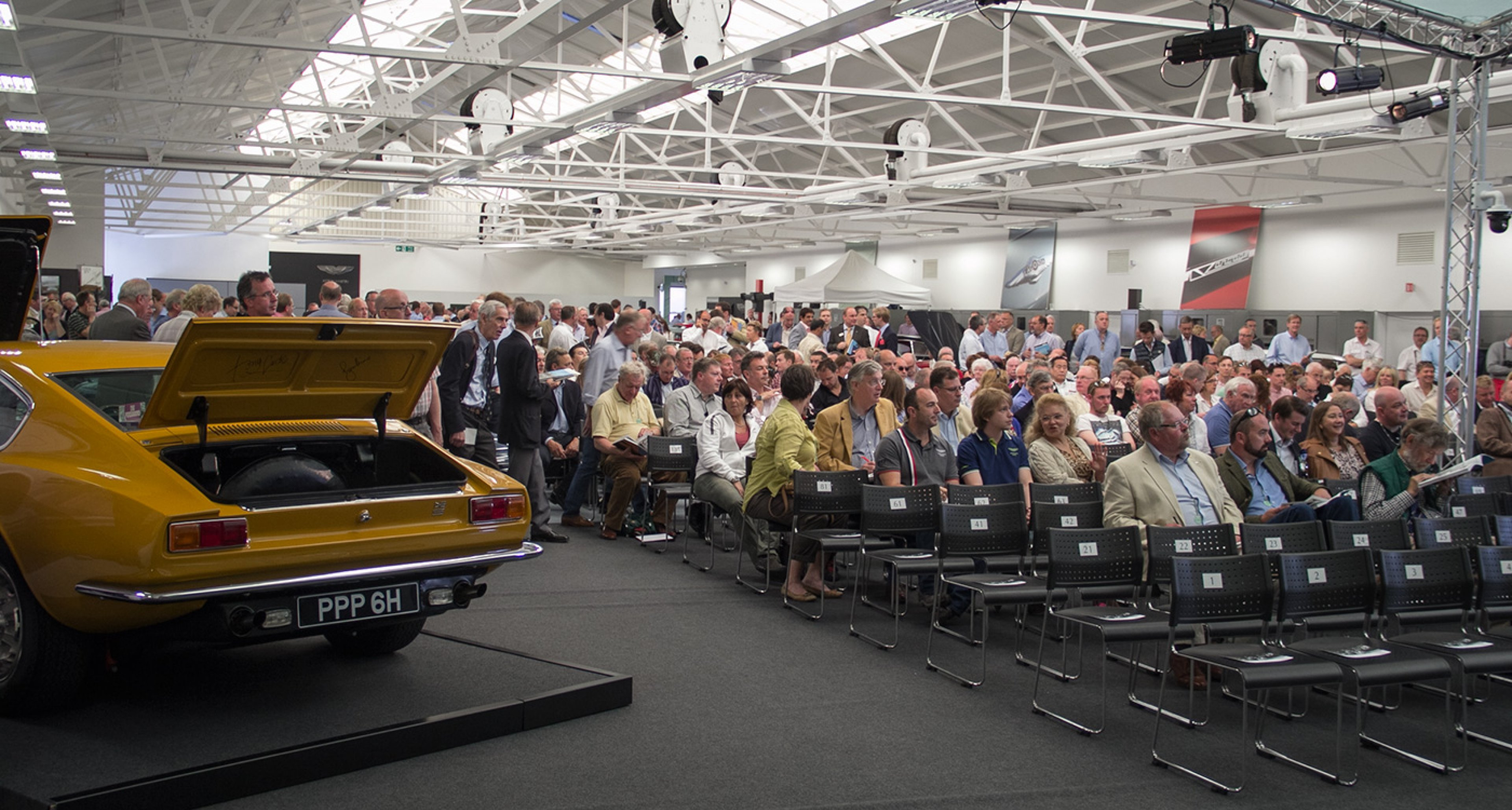 A record number of attendees witnessed frantic bidding wars at the single-marque sale
