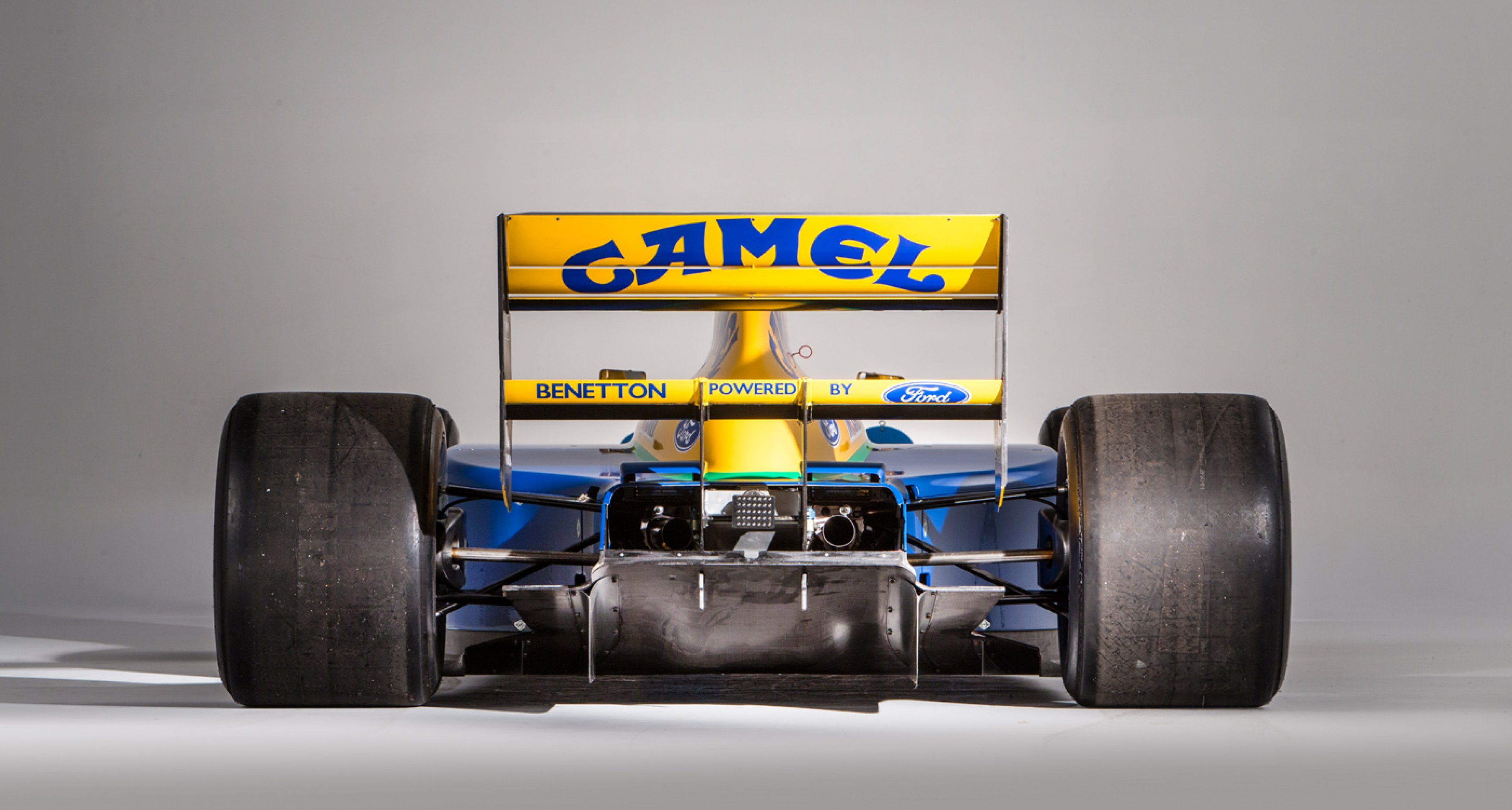 schumacher s first podium benetton f1 car to be auctioned. Black Bedroom Furniture Sets. Home Design Ideas