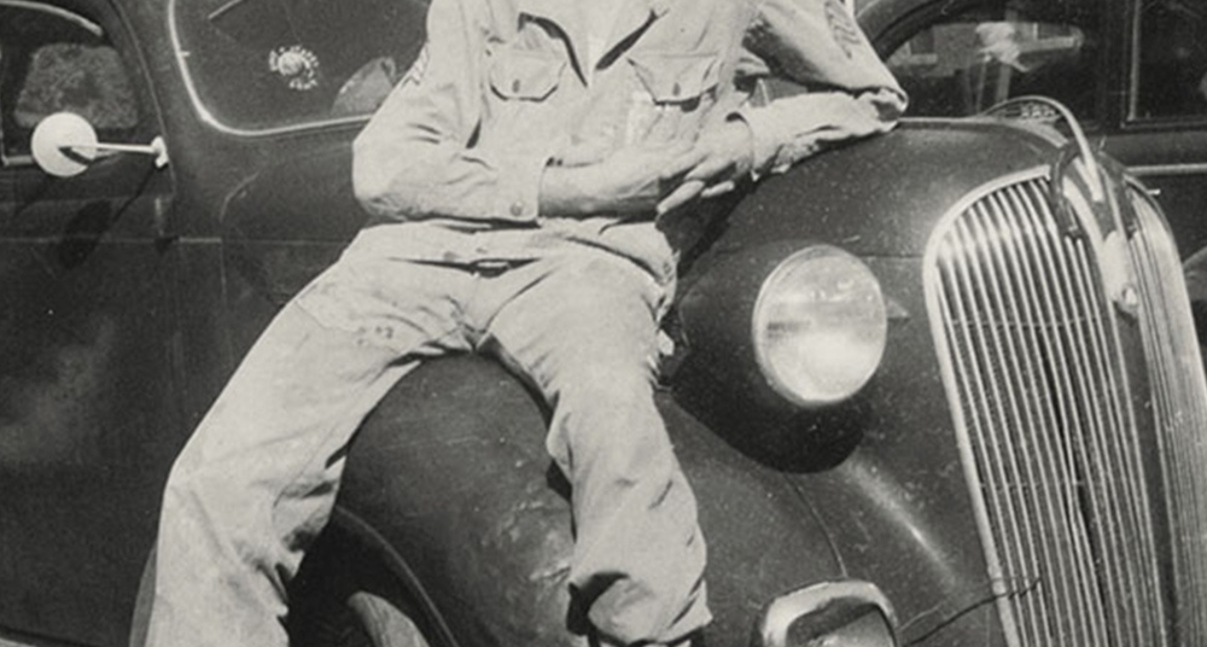 Stan lounges on the hood of his 1936 Plymouth sedan, his first car. / Courtesy Stan Lee