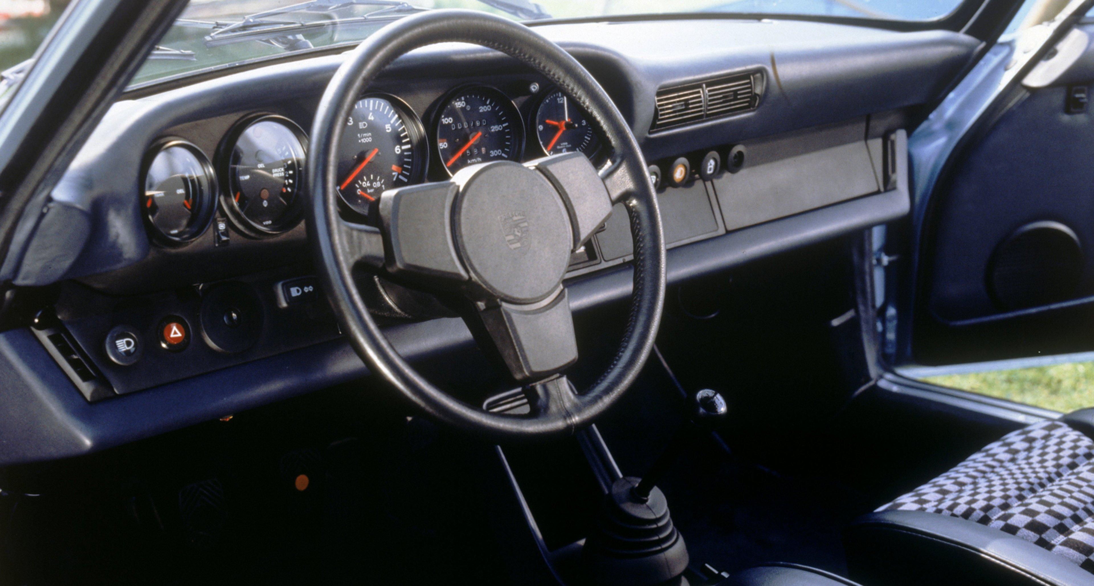 A 1978 Porsche 911 Turbo 3,3 Coupé with 'checkered flag' seats.