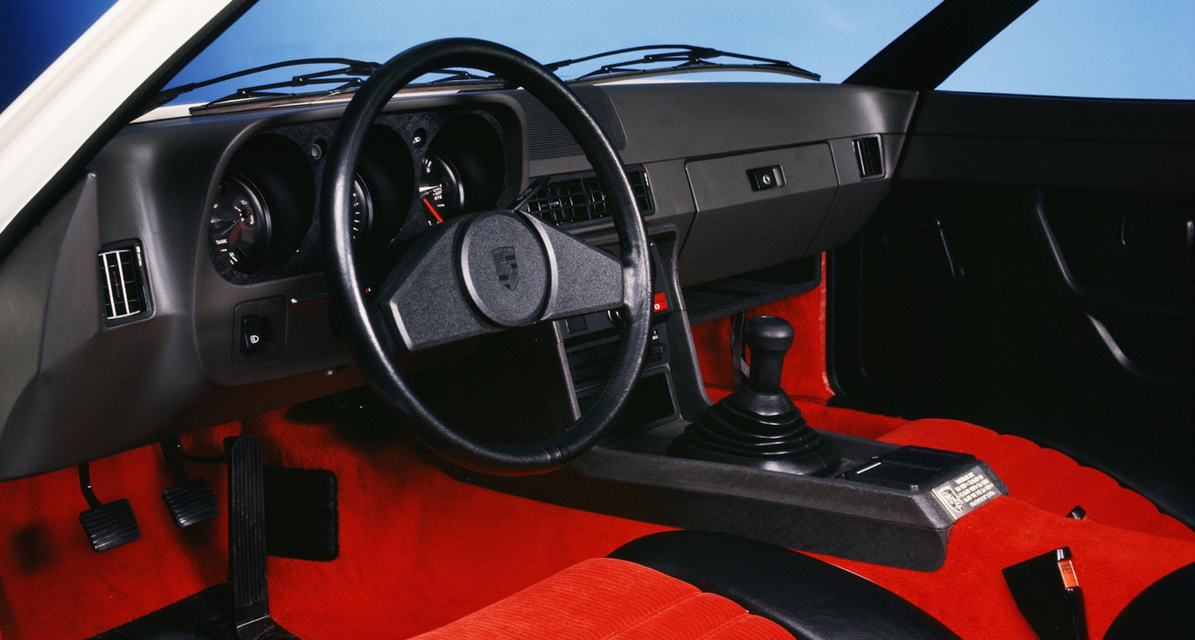 Red corduroy interior of a 1977 Porsche 924 Martini edition.