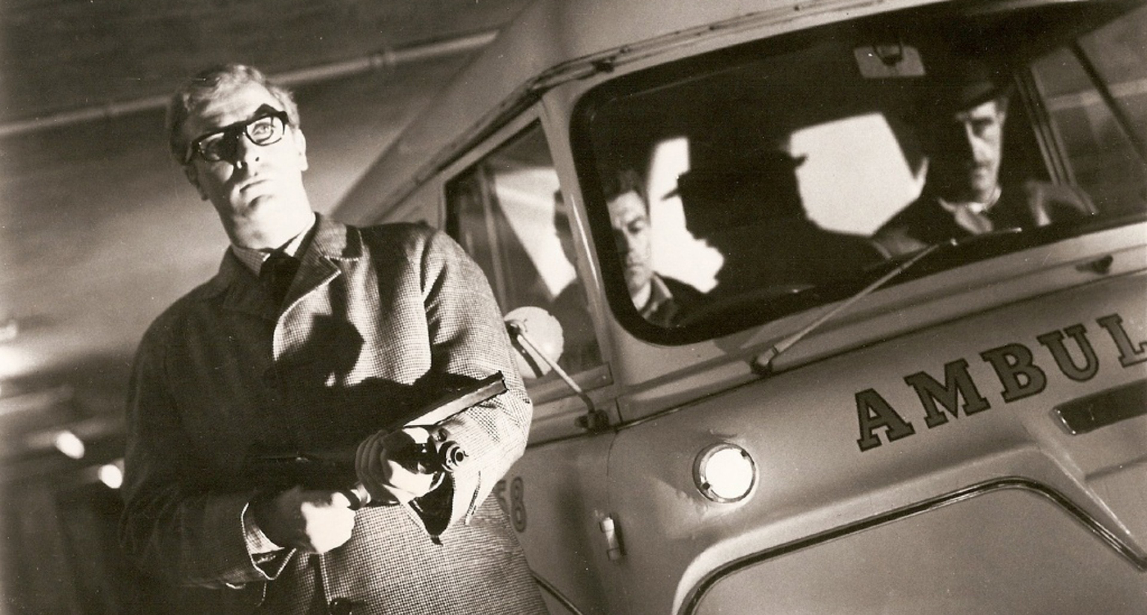 Caine and an ambulance in 'The Ipcress File' (1965).