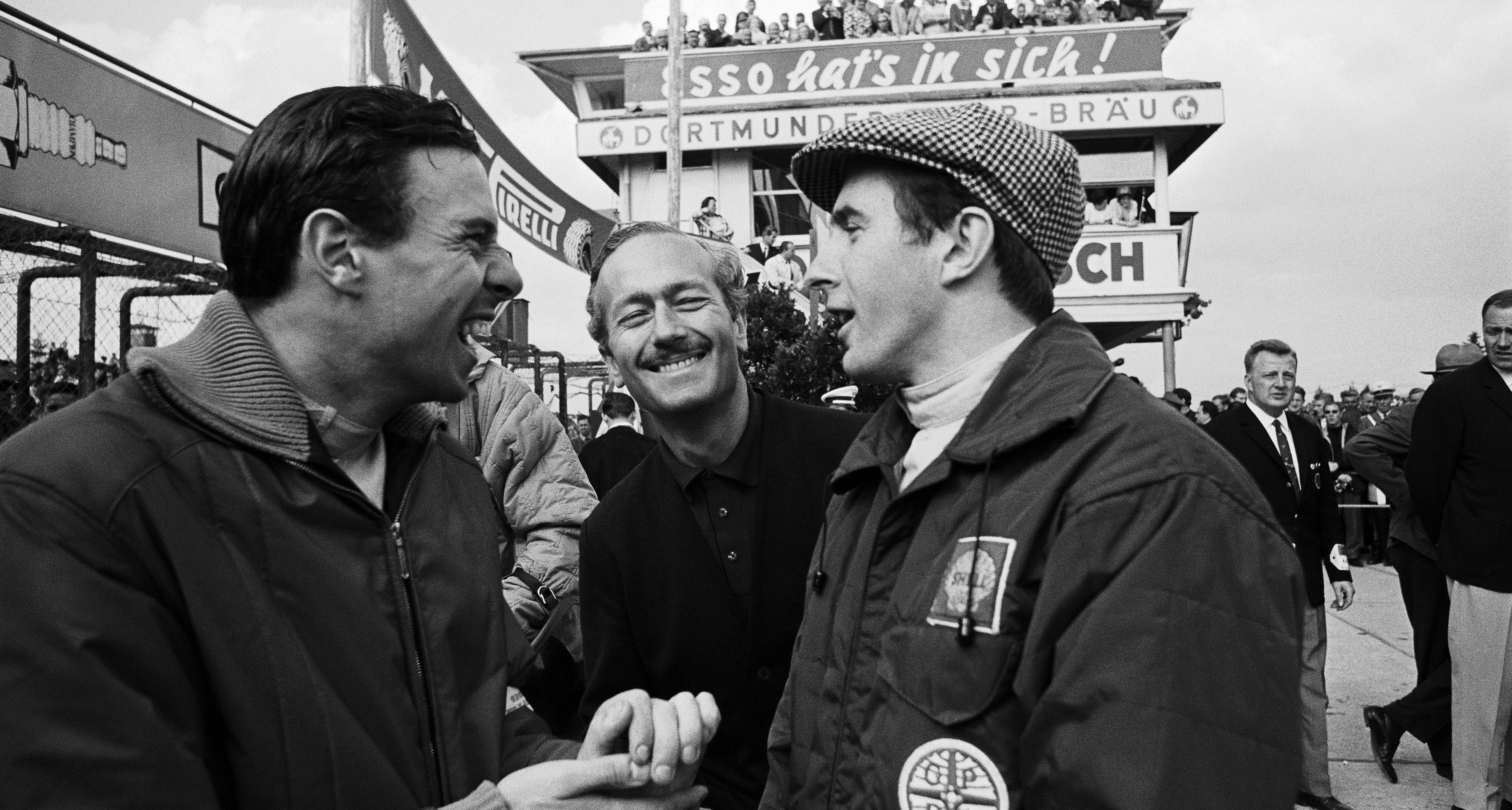 Jim Clark, Colin Chapman and Jackie Stewart joke around before the German Grand Prix 1965,