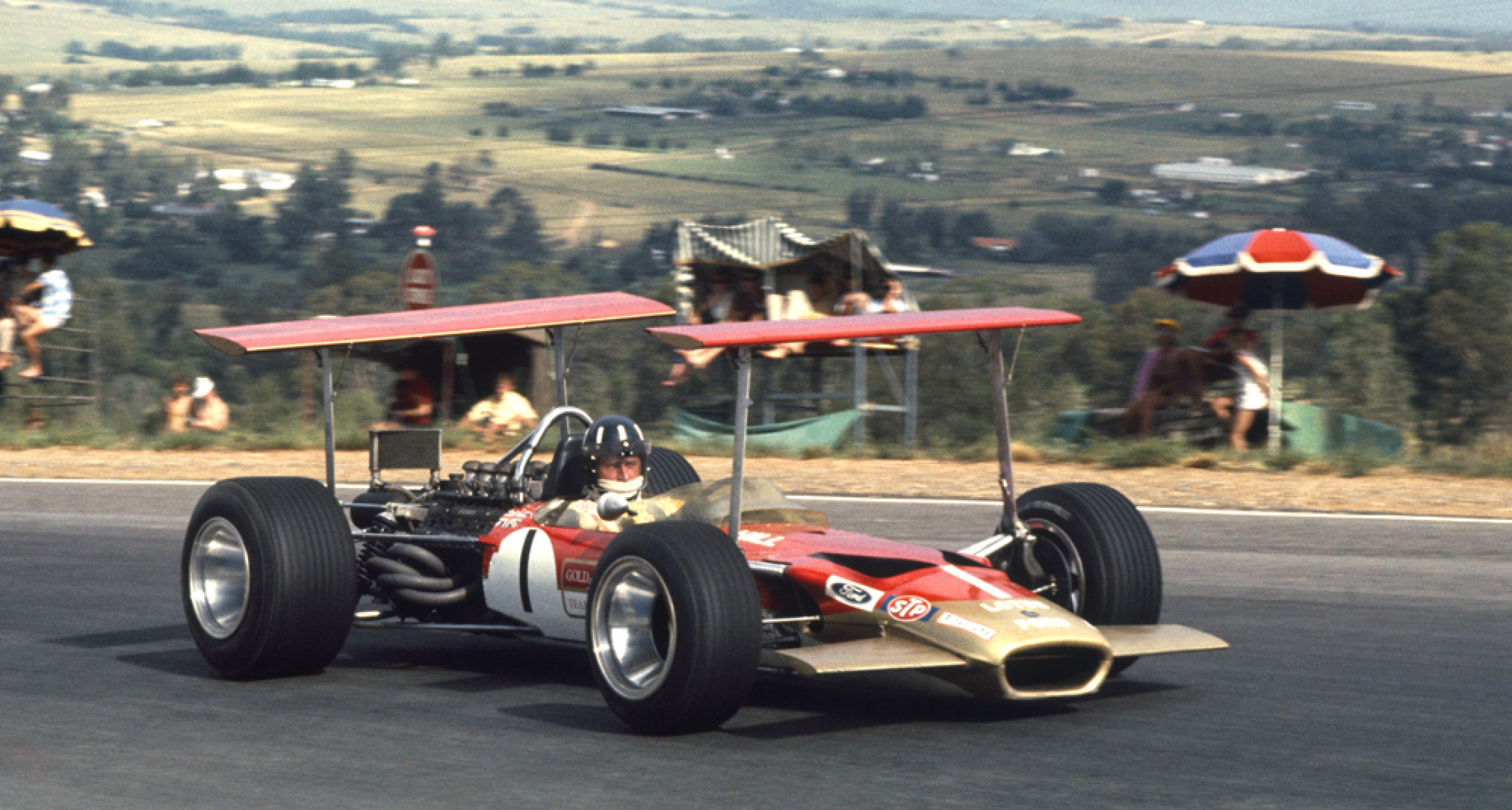 Kyalami, South Africa, 1969. Graham Hill in a Lotus 49B Ford on 2nd position.