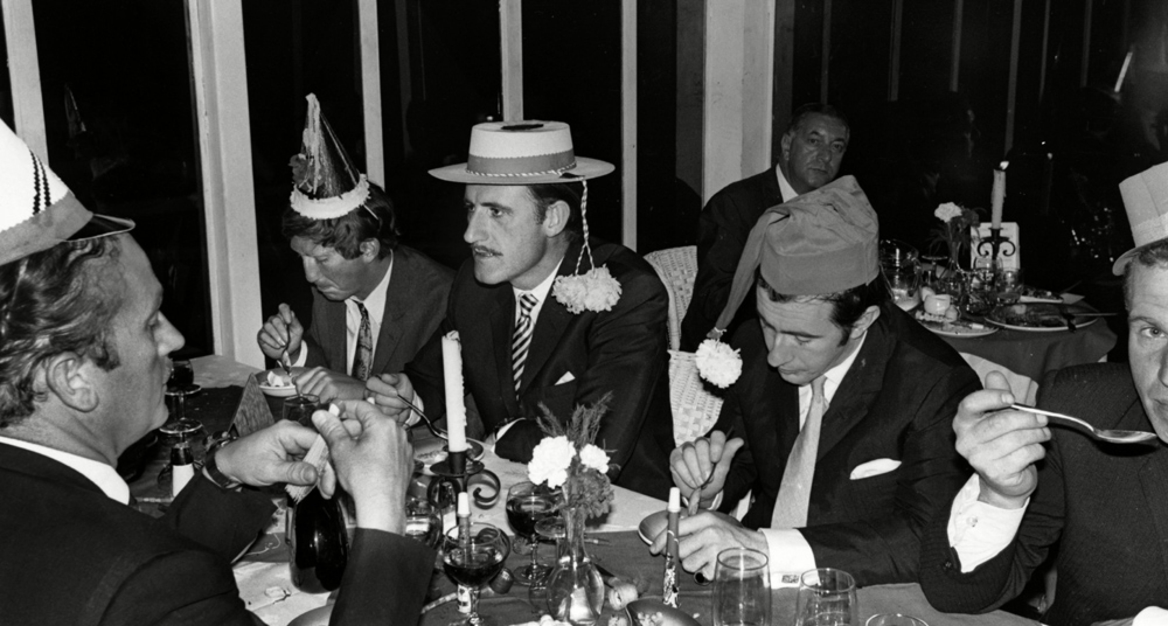 Kyalami, South Africa, 1968. Colin Chapman, Jochen Rindt, Graham Hill and Sir Jackie Stewart celebrate Christmas