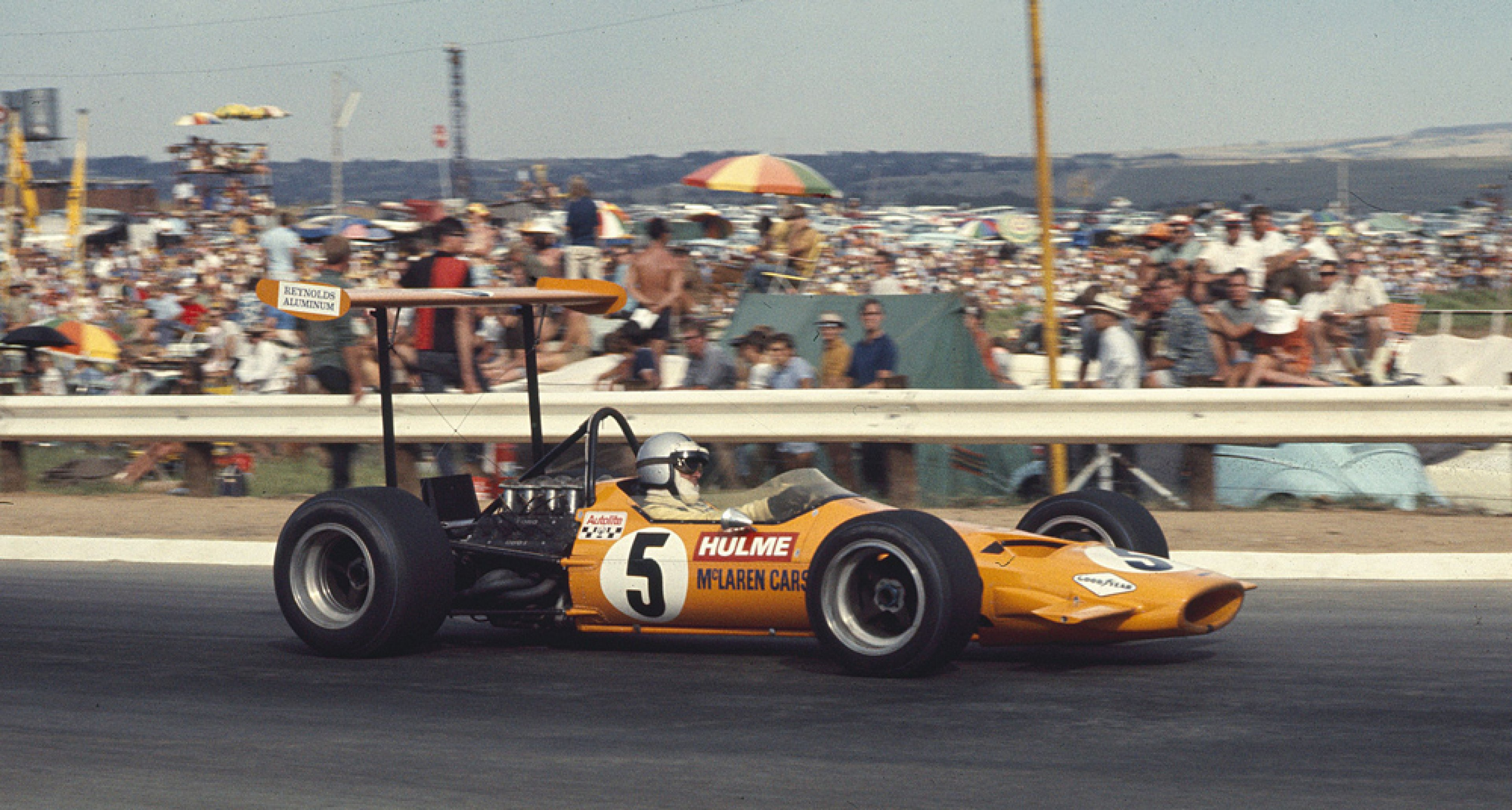 1969 South African Grand Prix at Kyalami. Denny Hulme in a McLaren M7A Ford on 3rd position.