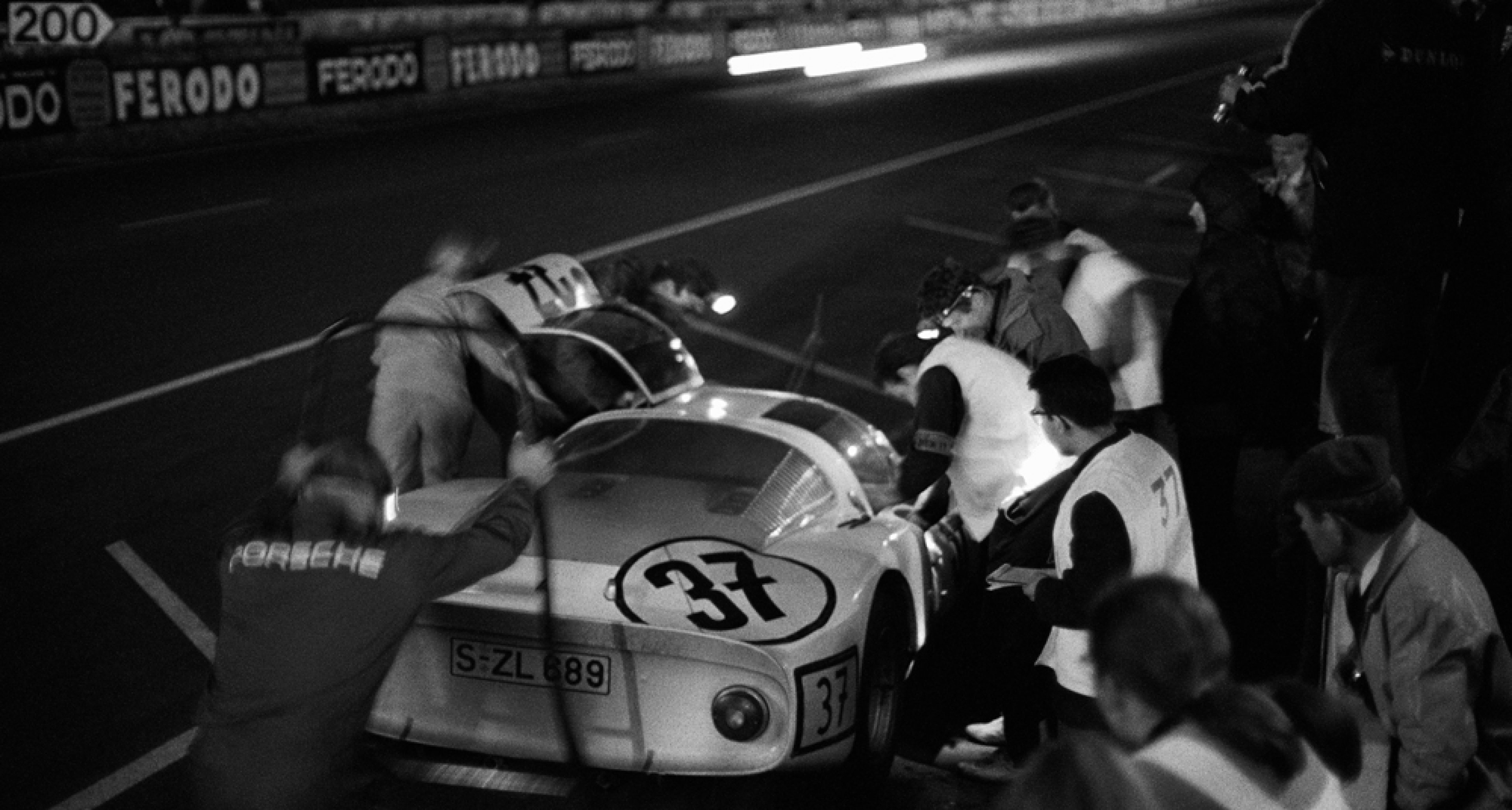 Nighly pitstop of seventh placed Vic Elford (GB) and Ben Pon (NL) in the Porsche 906 154, Le Mans, France, 10 June 1967.