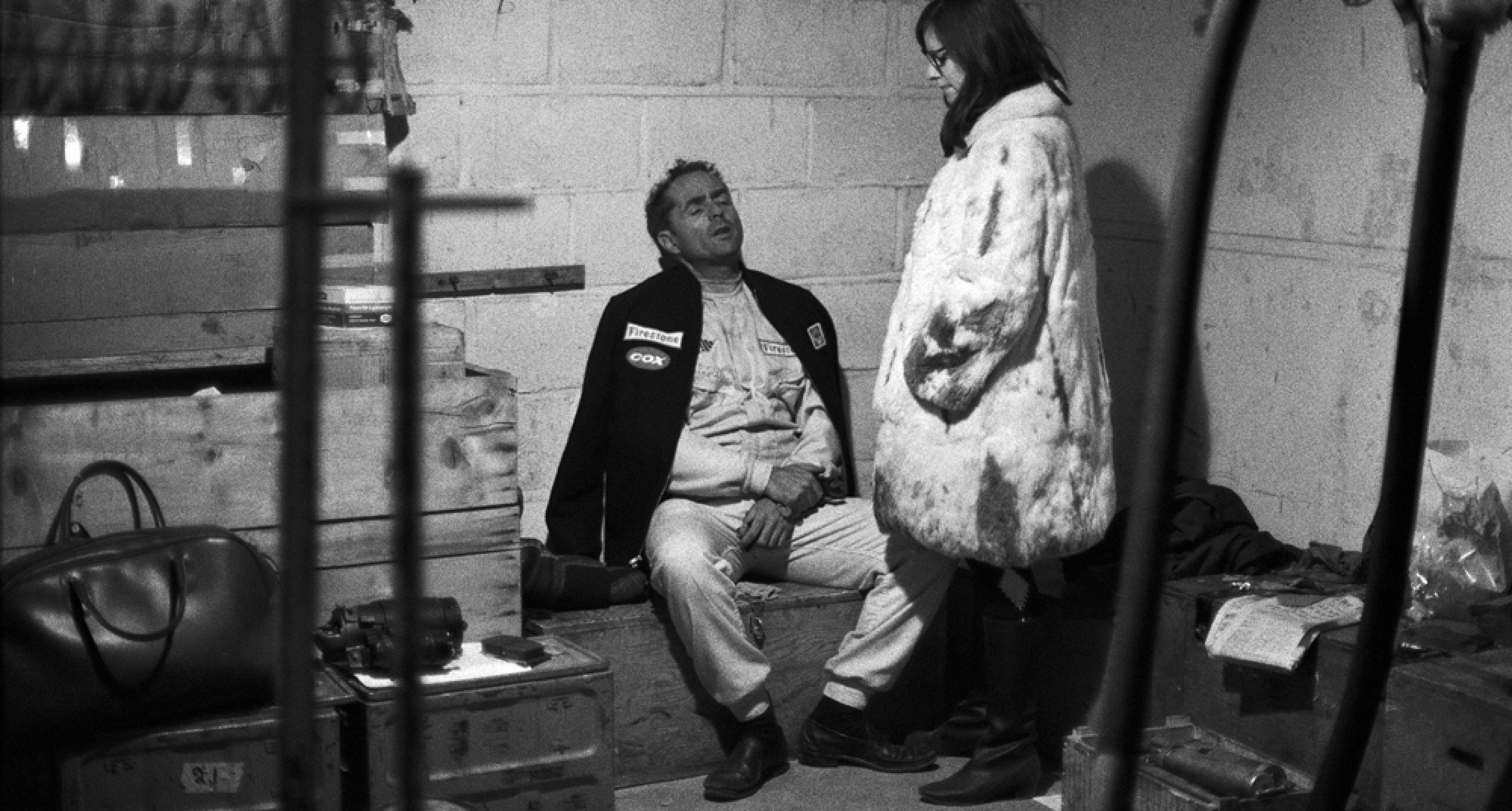 An exhausted Phil Hill relaxes in pits during the long race night of the 24h Le Mans 1967.