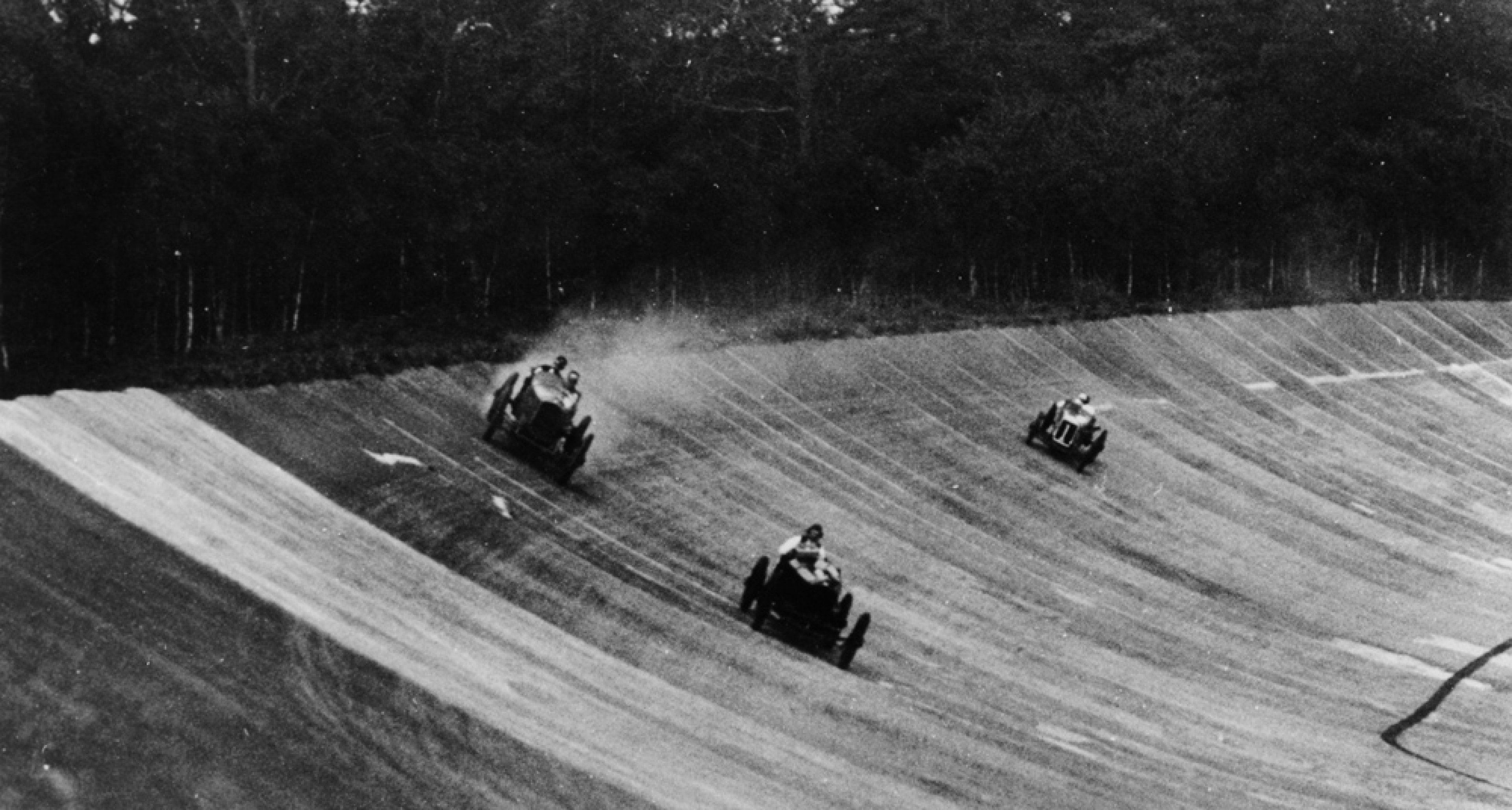Louis Zborowski passing Humphrey Cook's Ballot by skidding above him, Brooklands. Henry Segrave eventually won the race in a Sunbeam.