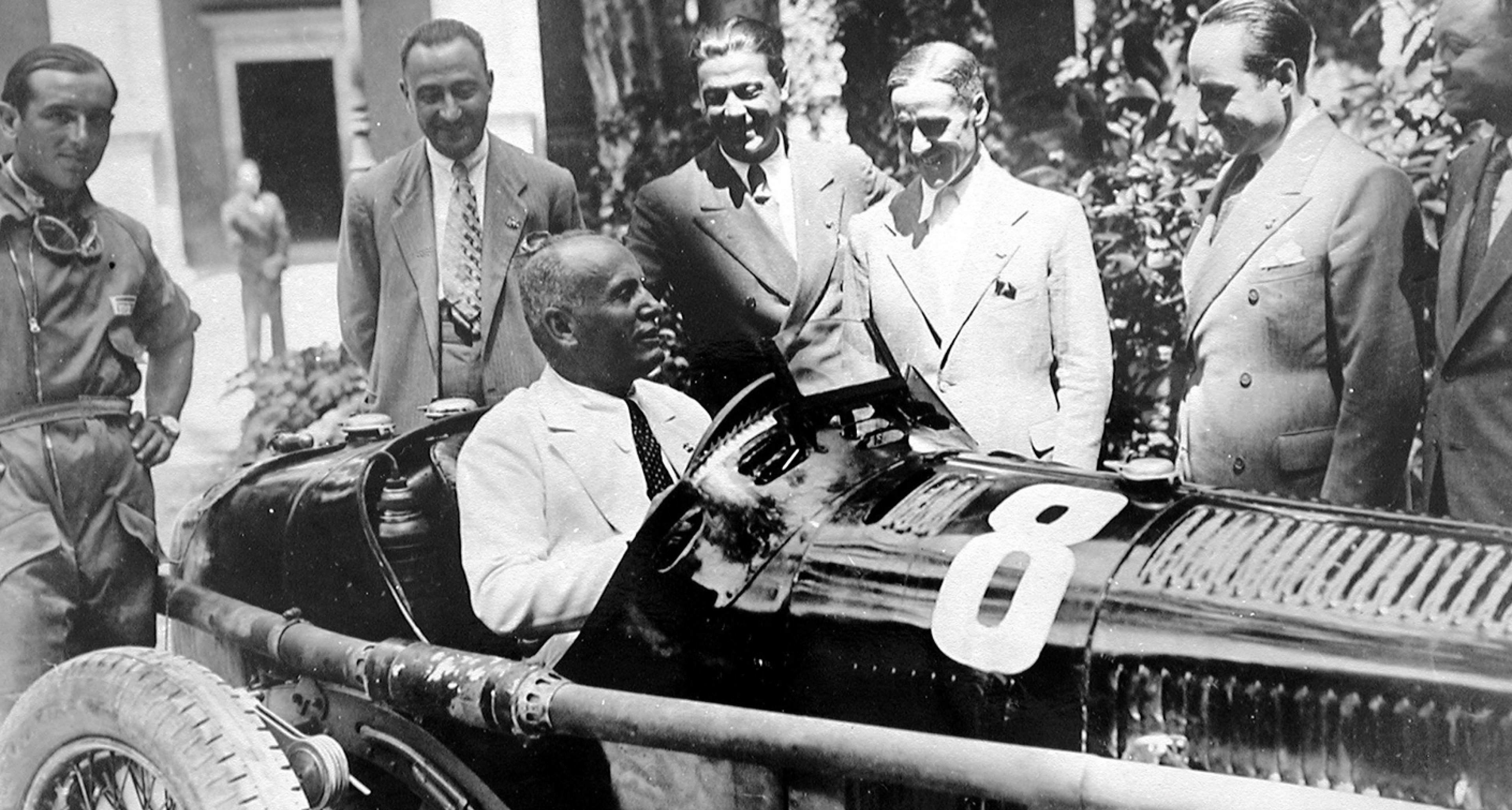 Mussolini meets Tazio Nuvolari (centre) and the Alfa Romeo team. He had commissioned a one-off V16 Maserati some years earlier