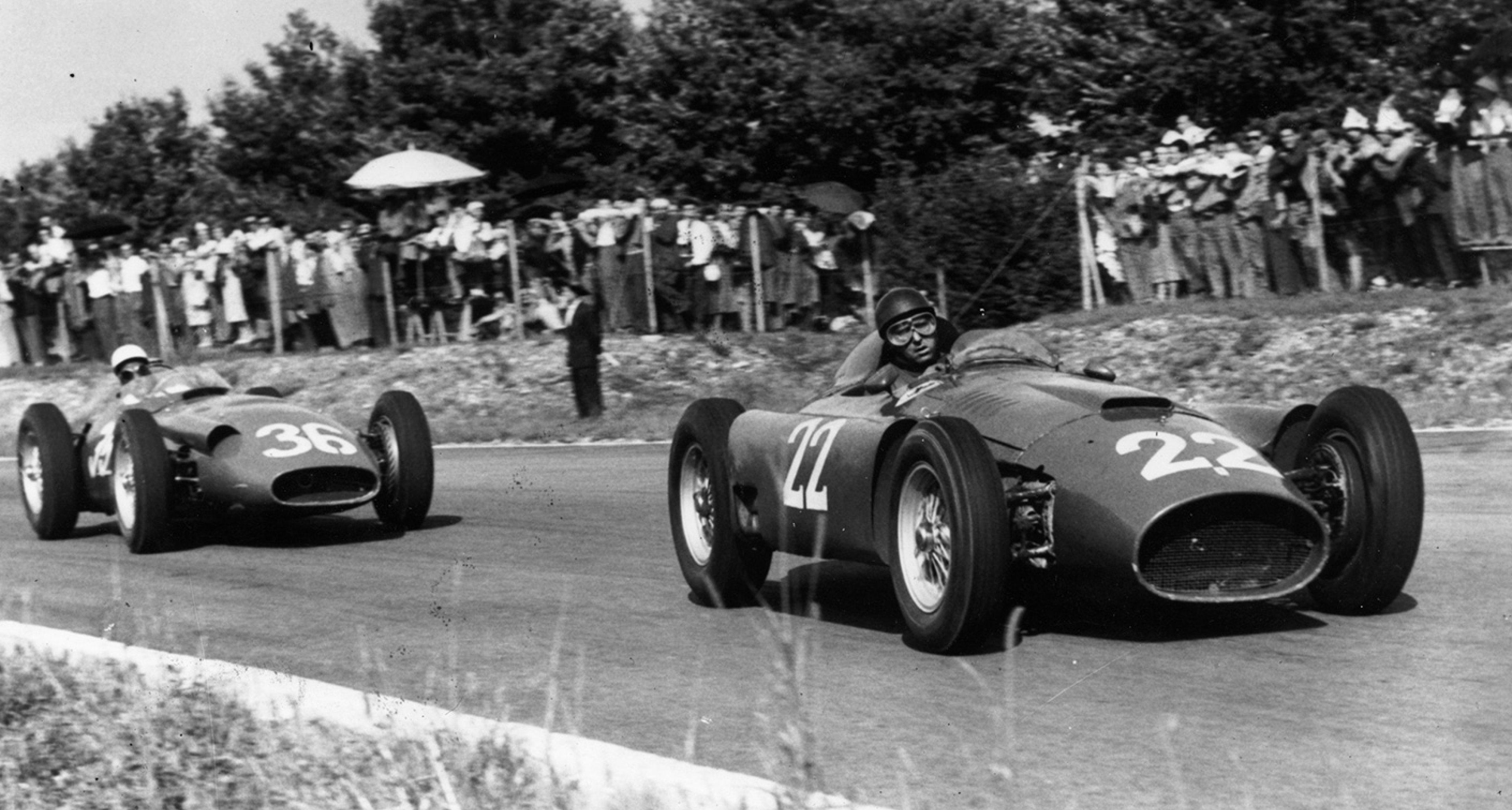 Fangio (Ferrari) leads Moss (Maserati) in the 1956 Italian Grand Prix at Monza.