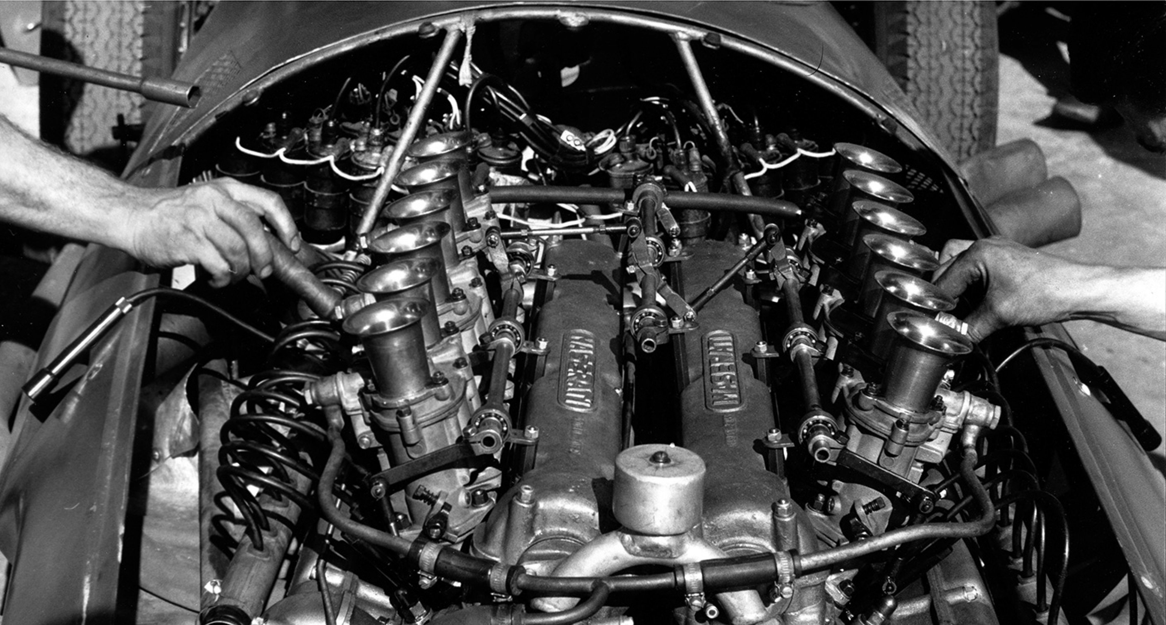 Last-minute tweaks to the V12 of a 250F at Pescara GP, 1957
