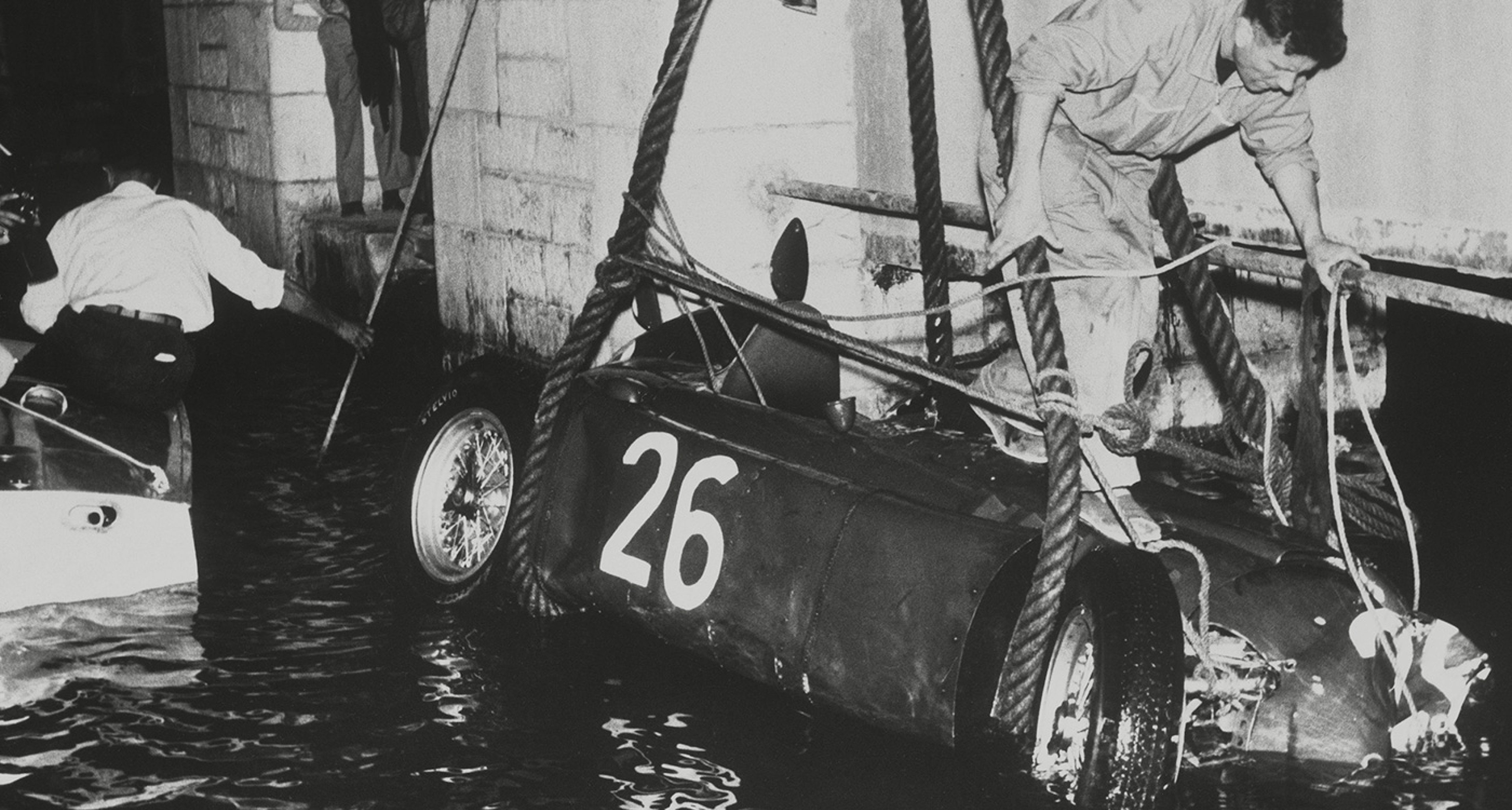 Ascari's Lancia is retrieved from the harbour waters in the aftermath of the 1955 Monaco GP