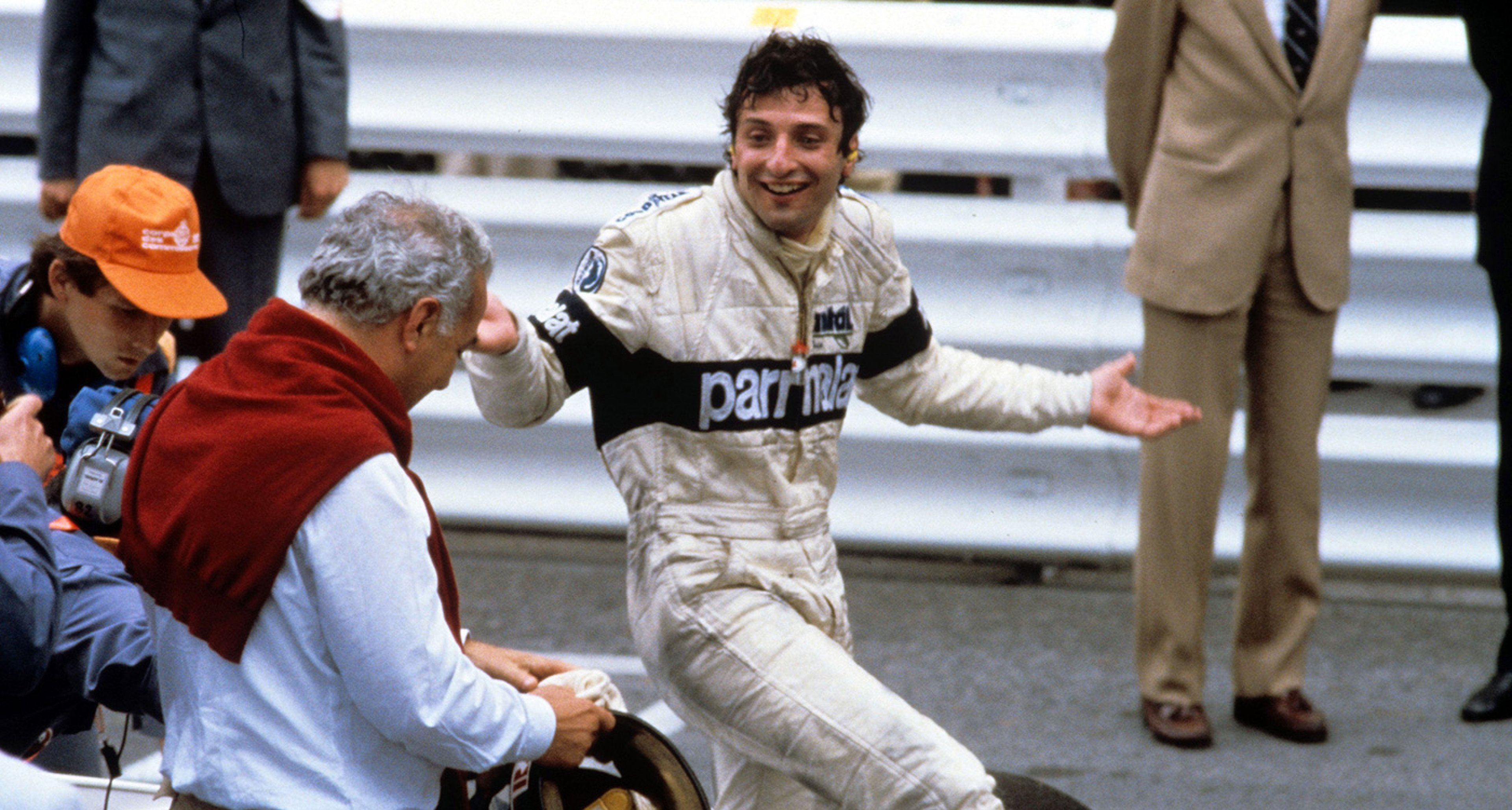 A confused Patrese learns of his win at an unbelievable Monaco GP in 1982
