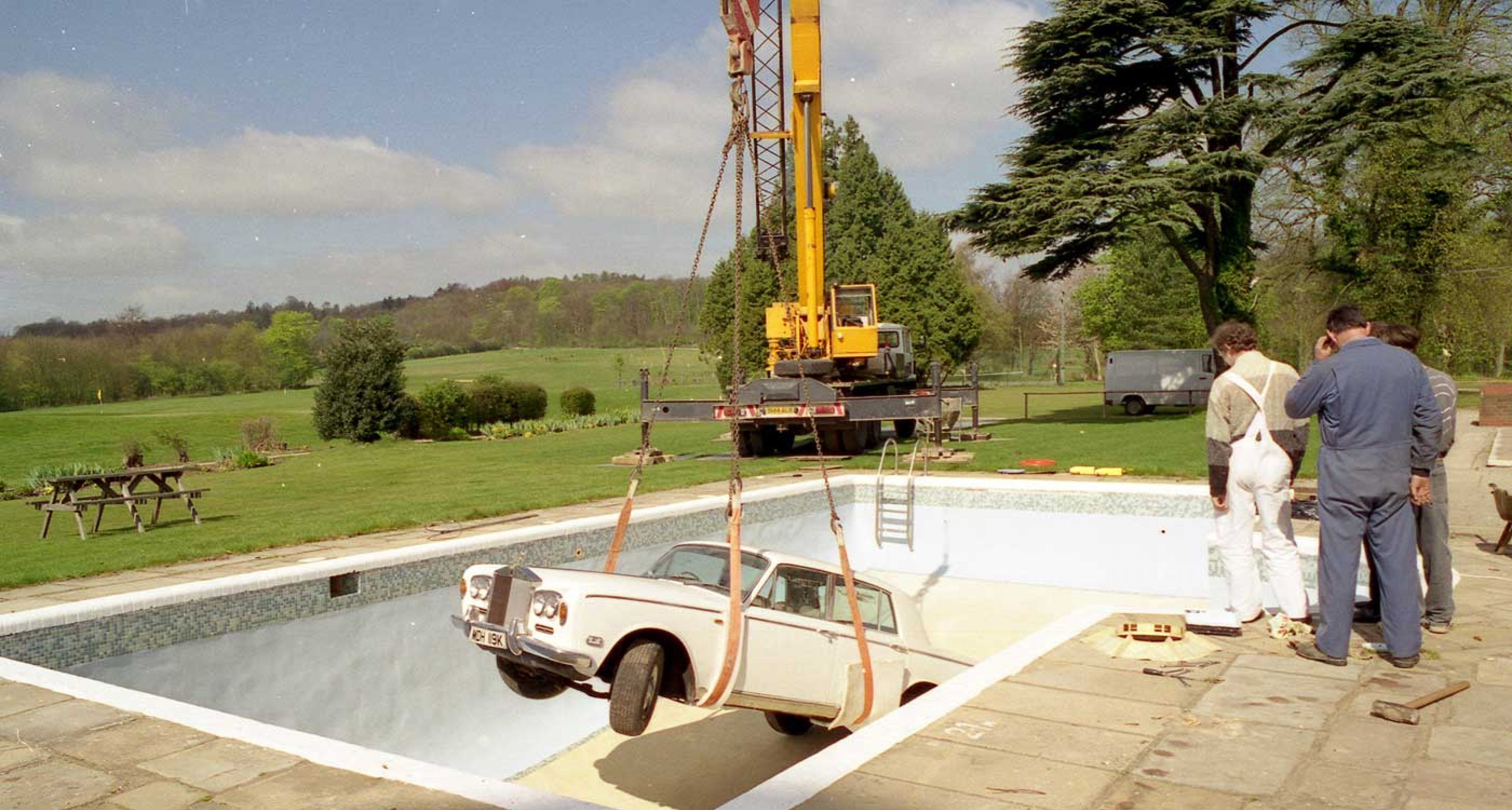 A heavy-duty crane was used to lower the Rolls into the empty pool