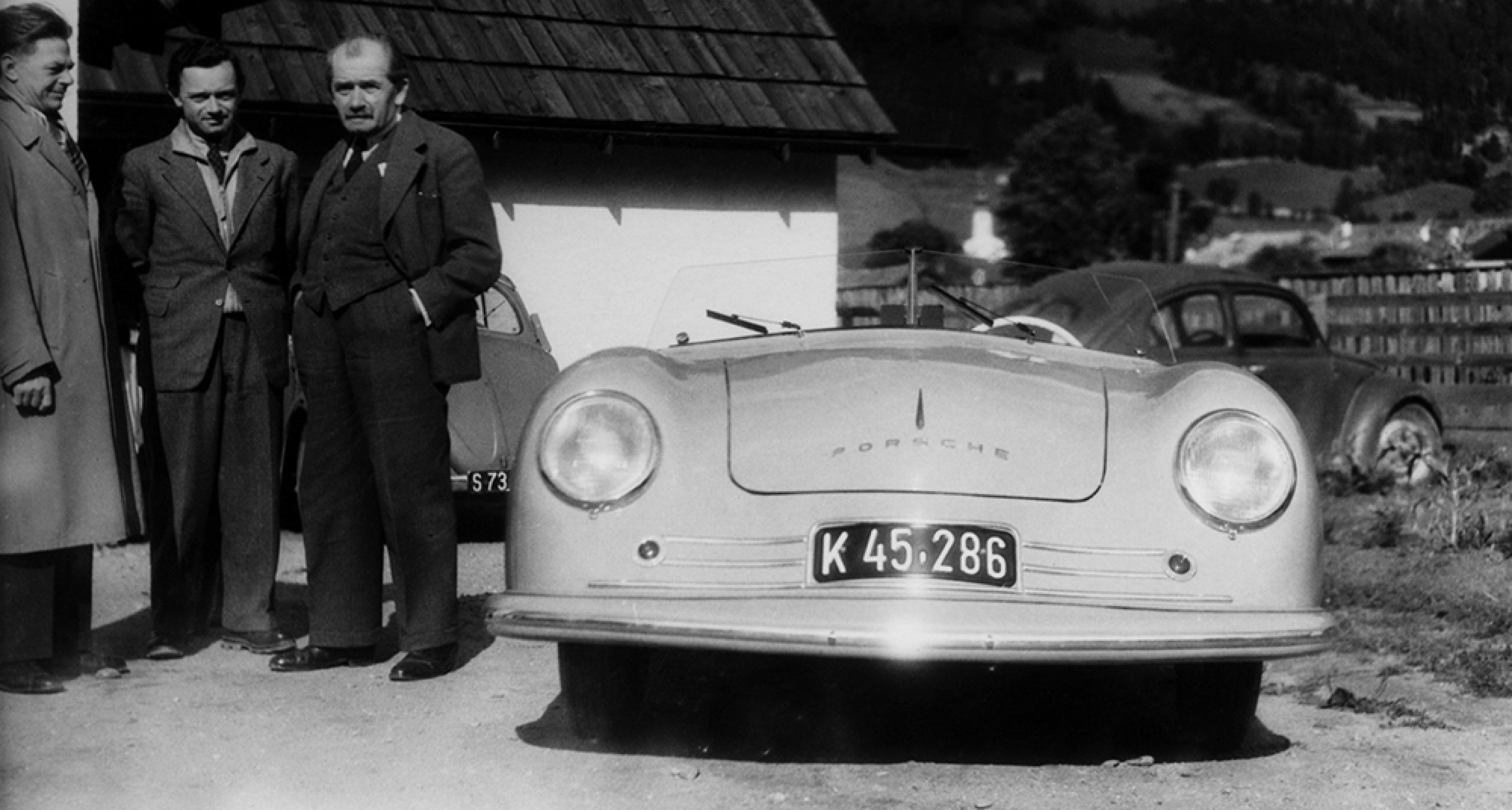 Ferdinand Porsche with the first car bearing the Porsche name. © Porsche archives