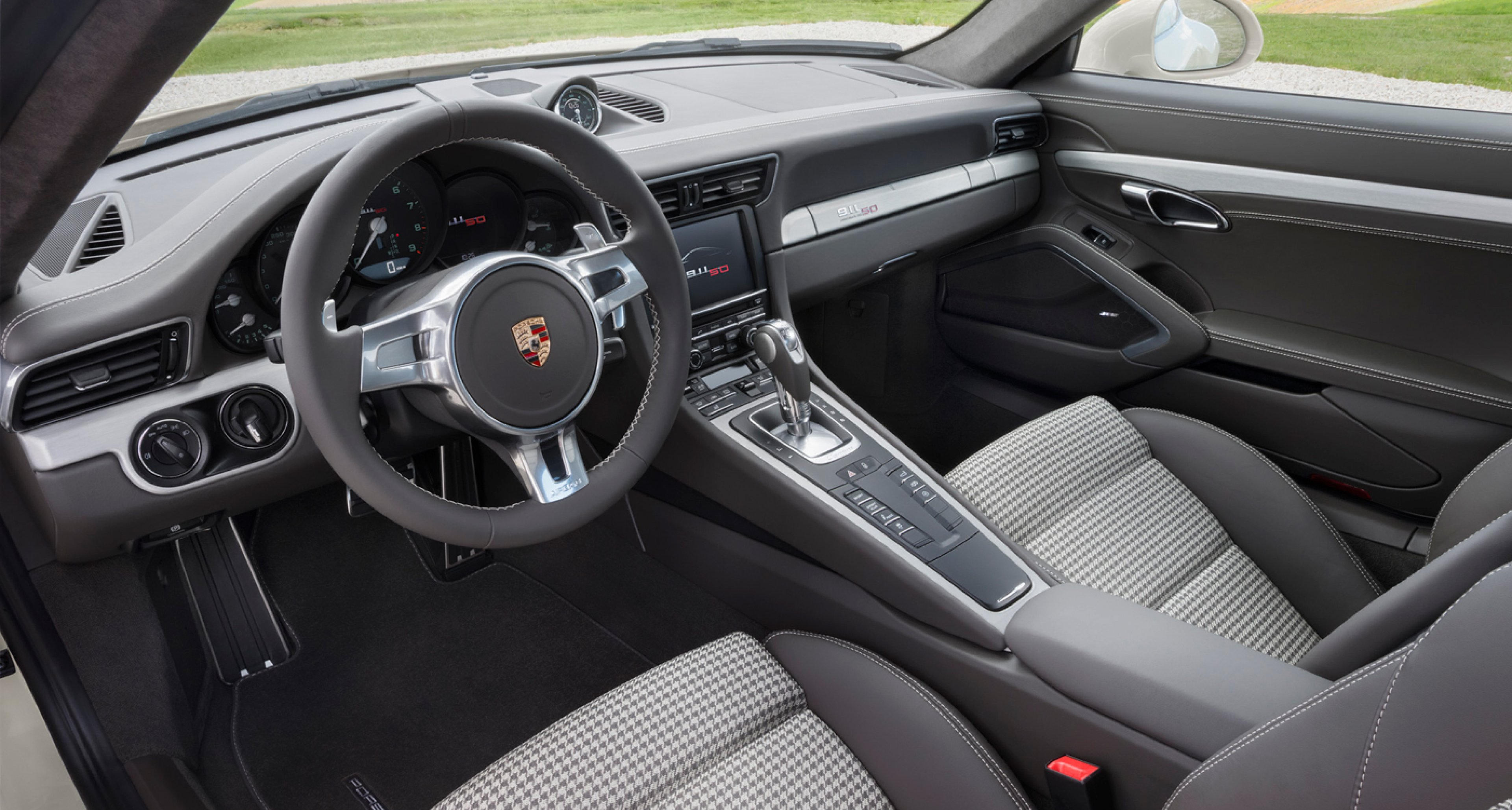 Celebrating 50 years of 911 with Pepita seats in the 2013 Porsche 911 anniversary model.