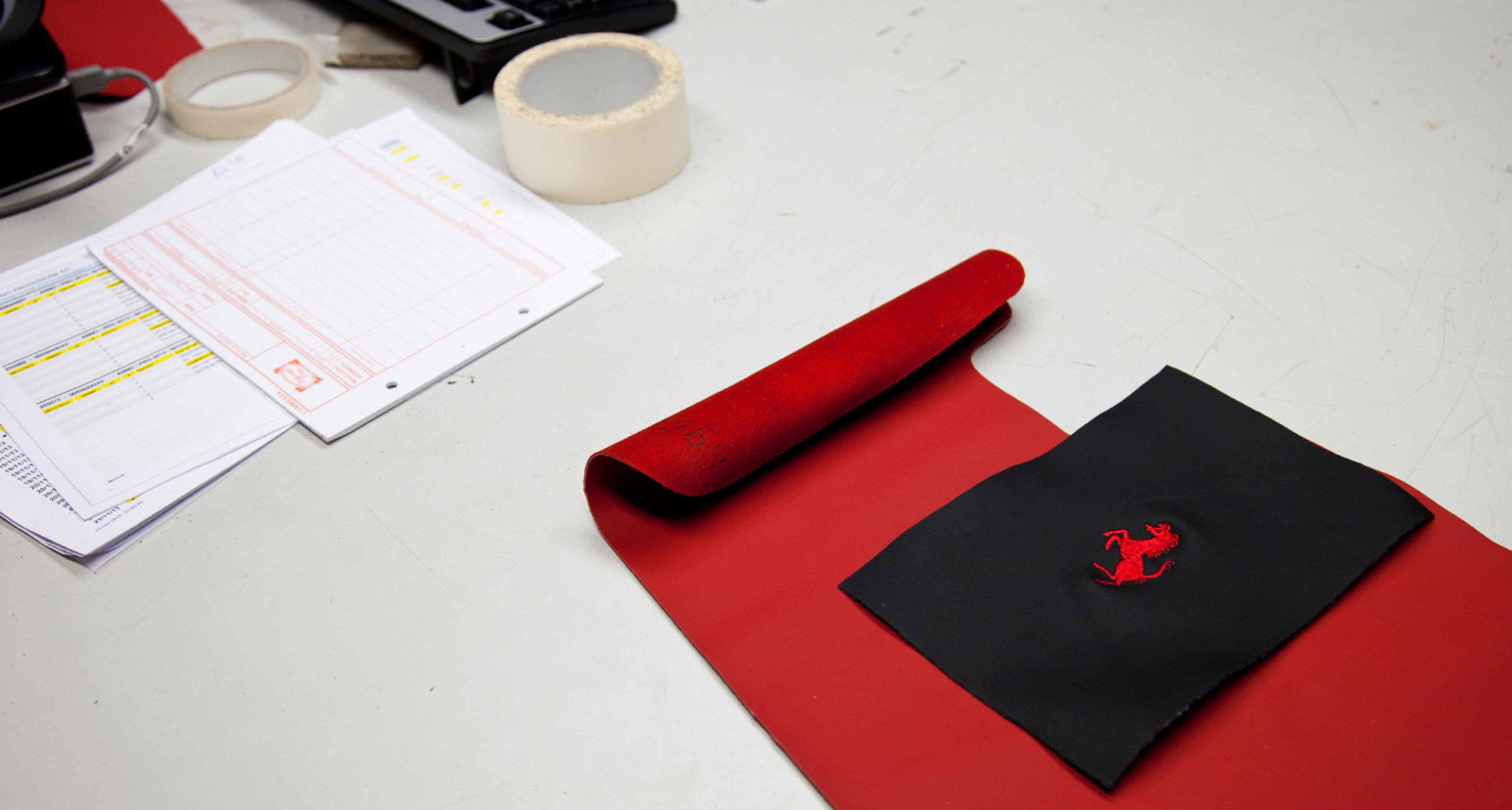 Ferrari logo samples at Poltrona Frau factory.