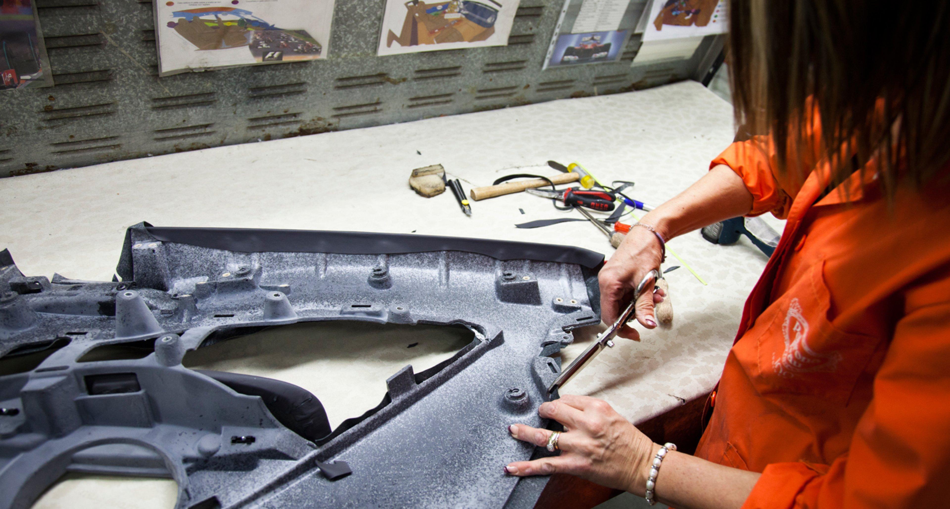 Preparing a Ferrari door at Poltrona Frau factory.