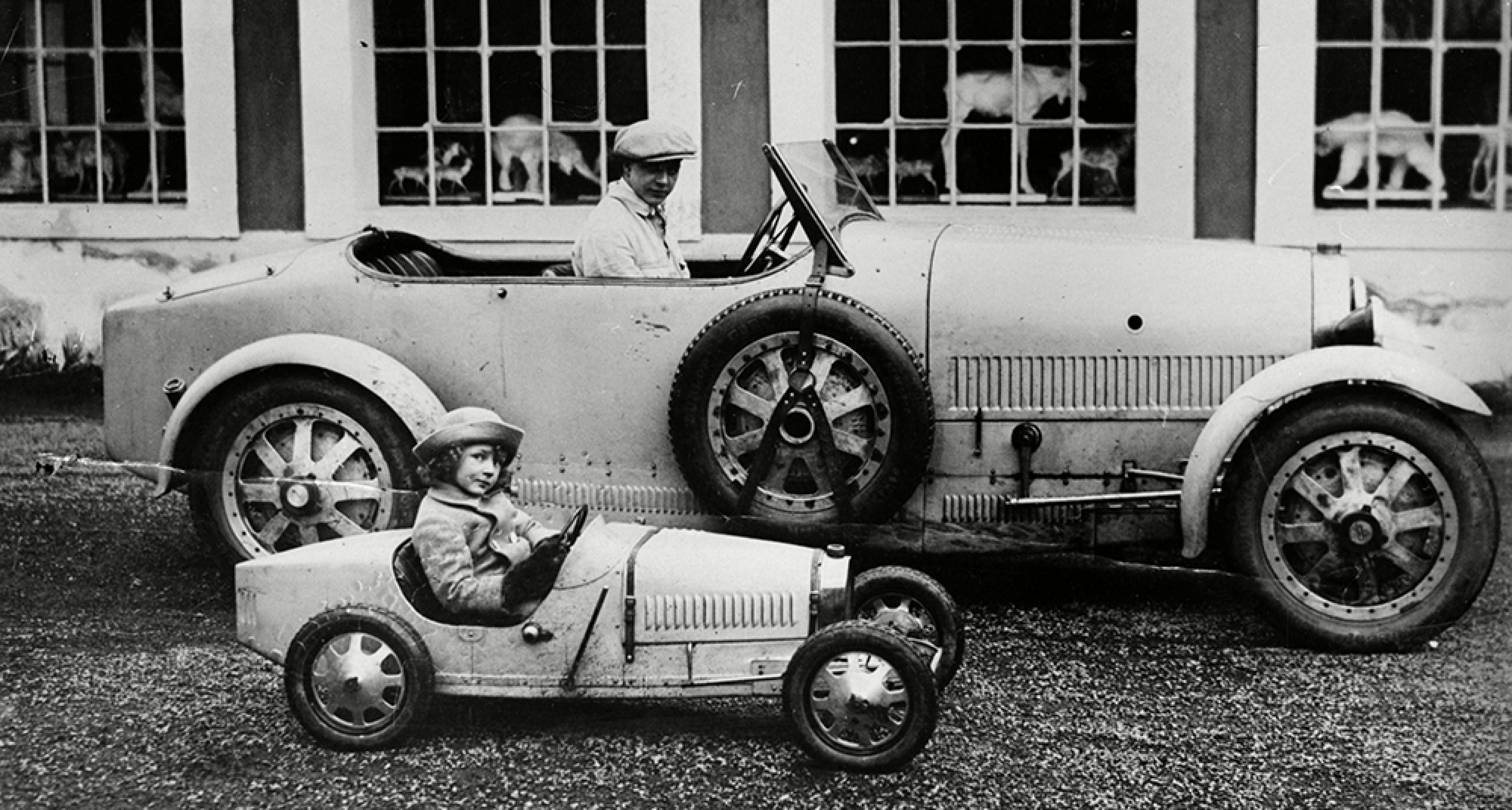 Jean and Roland, sons of French car manufacturer Ettore Bugatti in a car manufactured by their father. © Rexfeatures