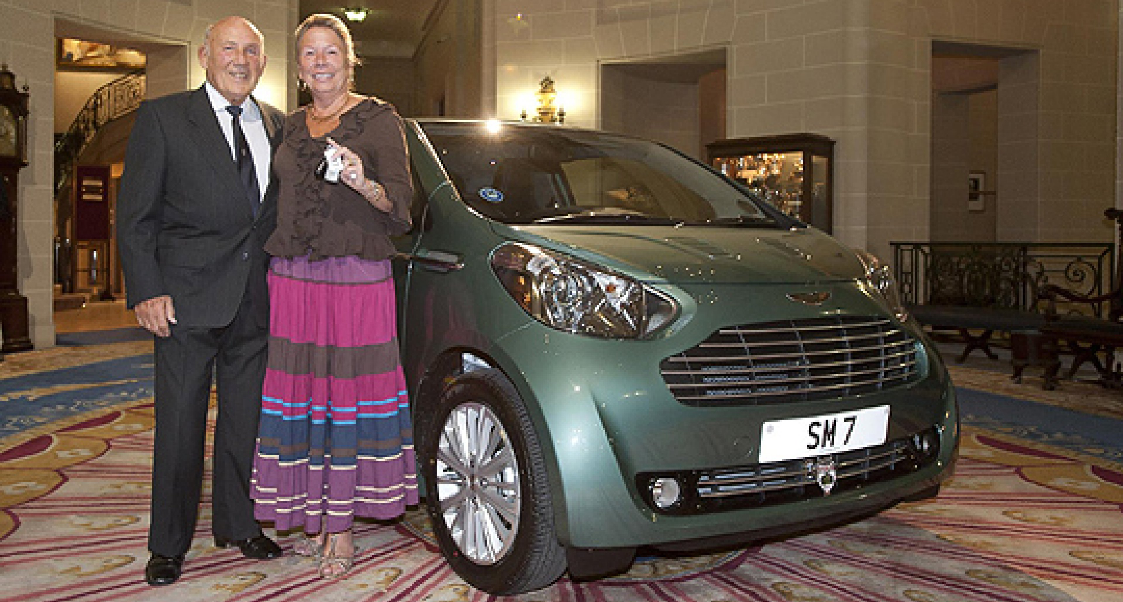 Sir Stirling Moss and the Aston Martin Cygnet: a surprise birthday present for Lady Susie